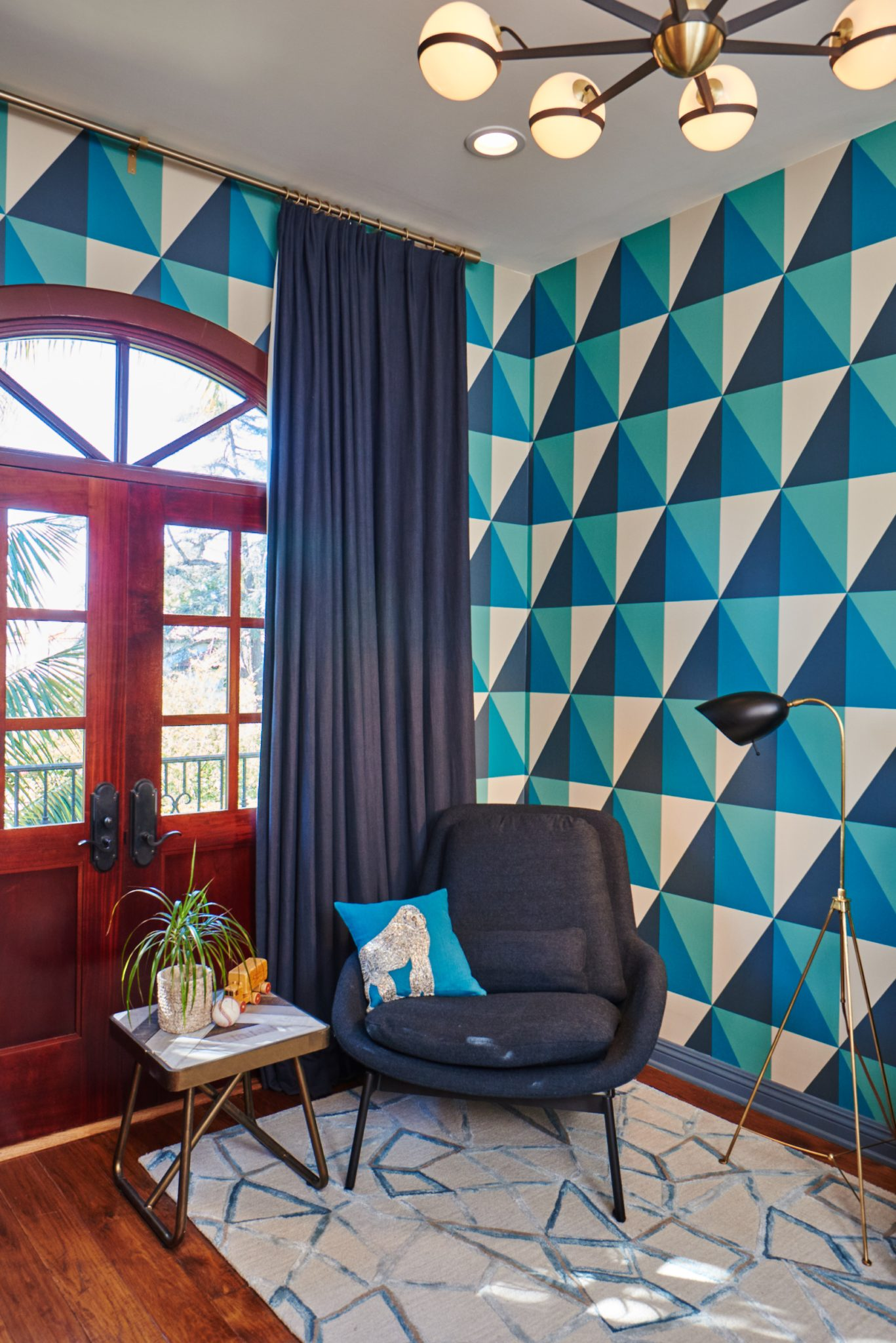 Geometric wallpaper in navy, teal and oatmeal creates graphic appeal. by Sarah Barnard Design