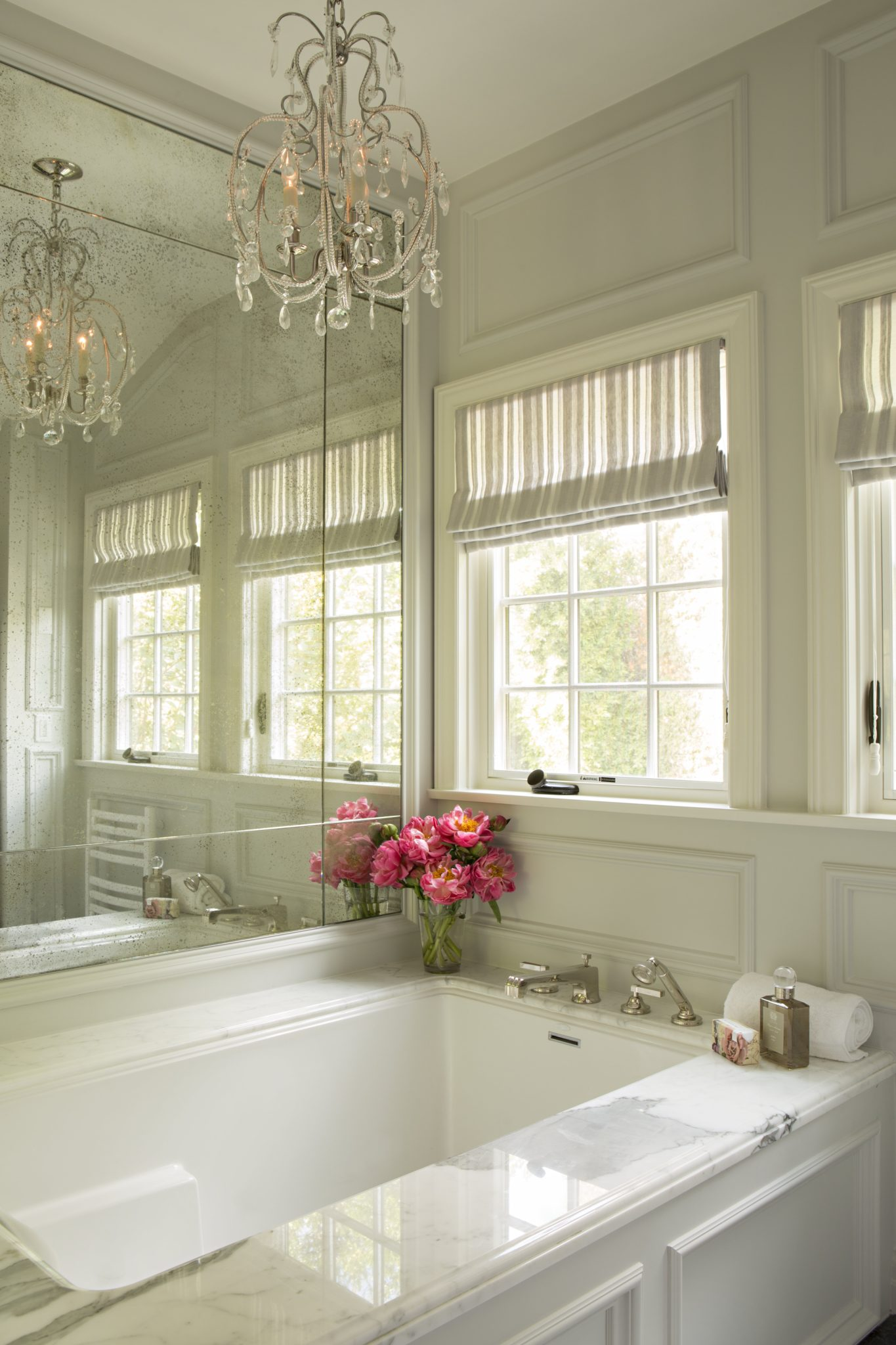 Master Bathroom with antique mirror and white marble details by Jackson Paige Interiors