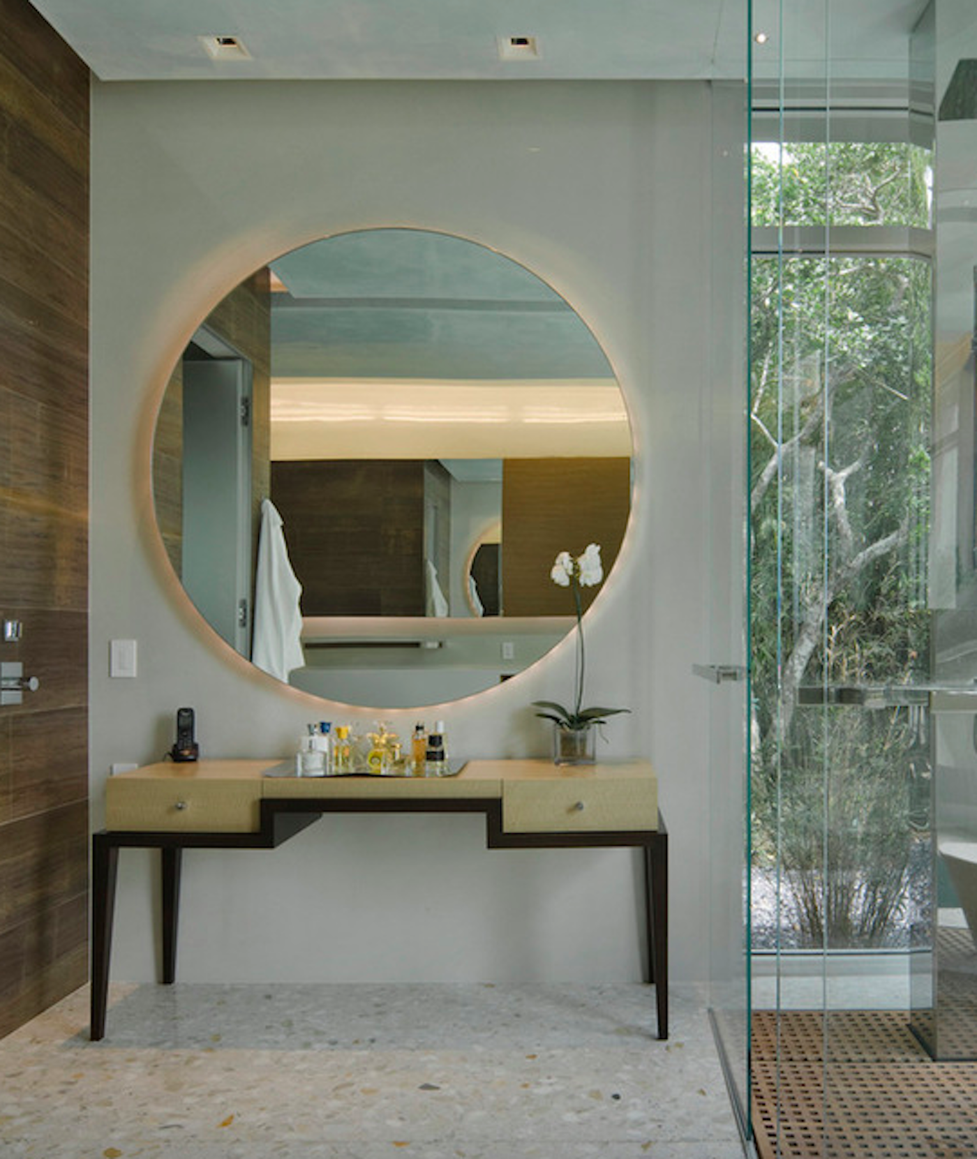 Custom vanity table with large round mirror atop. by Michael Wolk Design Associates
