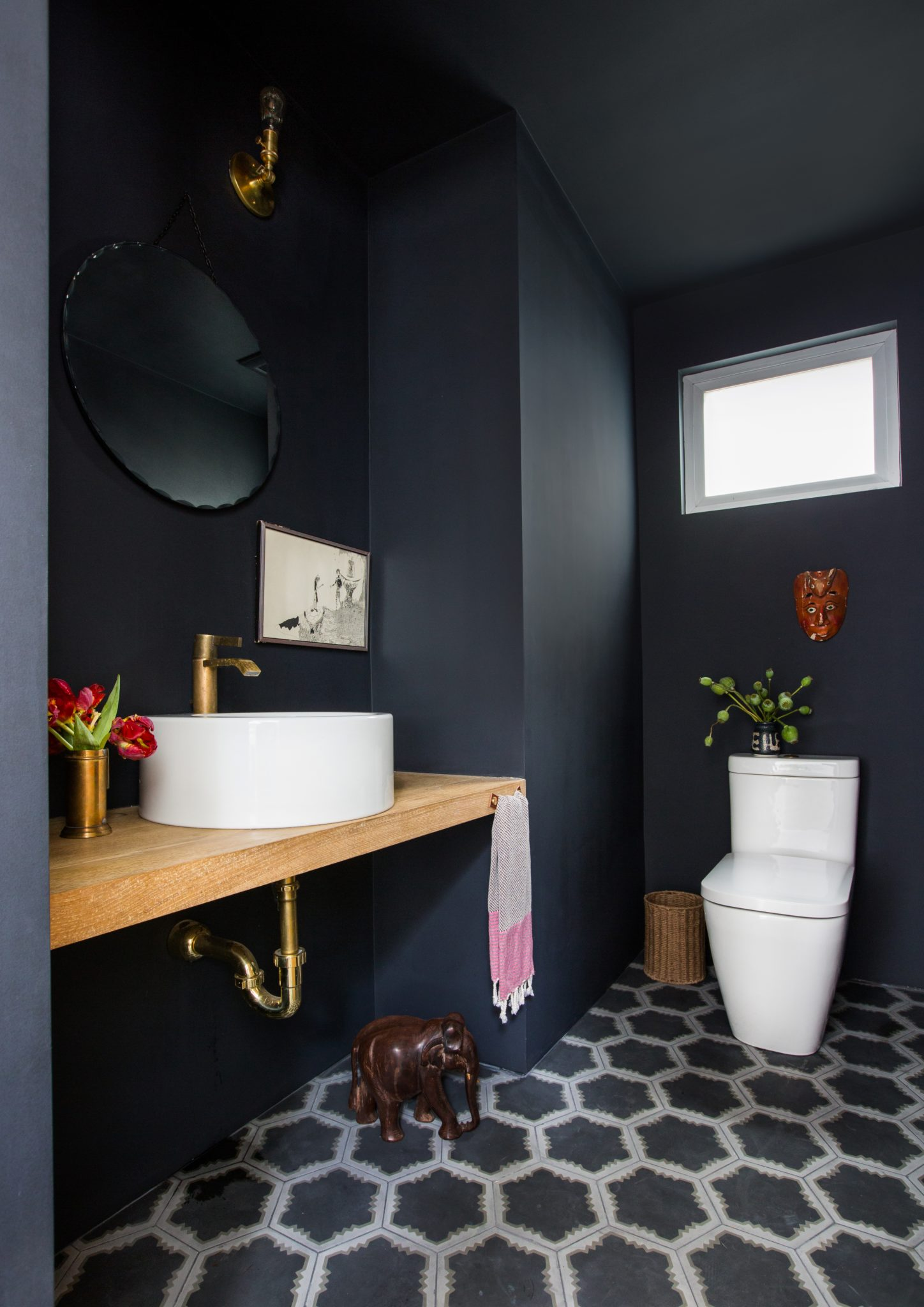 Powder room in black with cement tile, white oak and brass by Stefani Stein Inc.