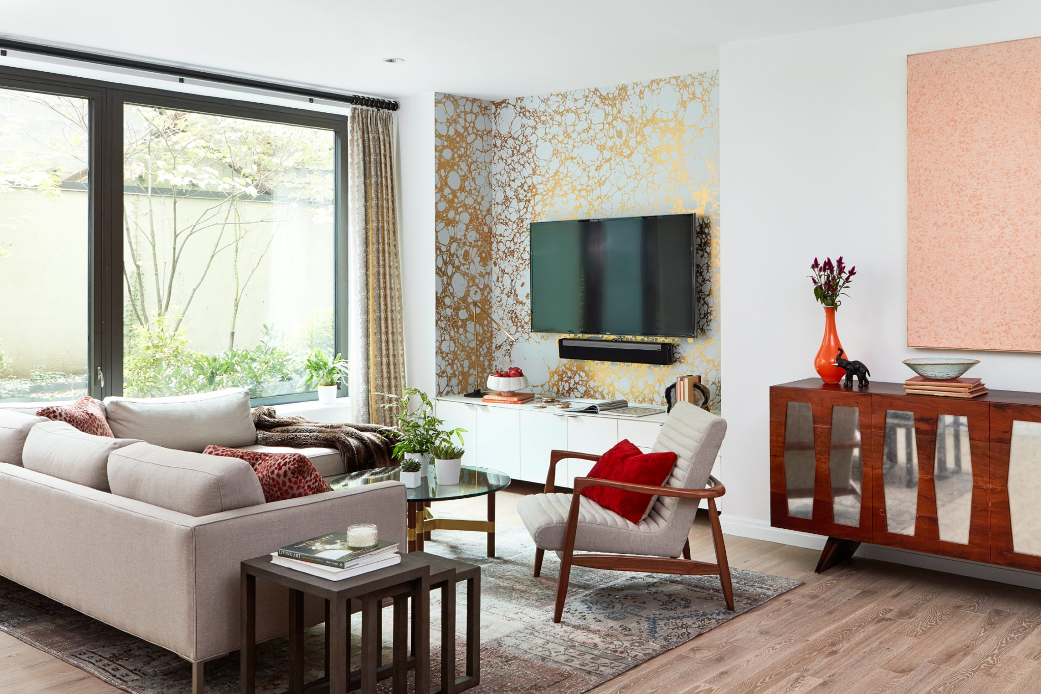 Manhattan Mid-Century living room with calico wallpaper and outdoor space by Allison Garcy Interiors