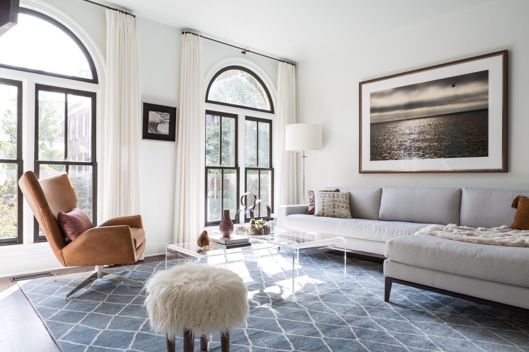"""""""This project is one of my favorites because it reflects our core philosophy of simplicity and ease. It depicts our love of creating light-filled spaces, working with neutrals, and incorporating a range of textures to add interest, depth, and warmth. When our client purchased this townhouse, it was closed in, dark, and dated. We were able to transform it into an open, light-filled, serene modern oasis. This would not have been possible without her trust, an integral part of the process for us. Our goal was also to infuse her vibrant personality into the space — and to do that, we included some whimsical, fun pieces throughout."""" — Celia Welch, Celia Welch Interiors"""