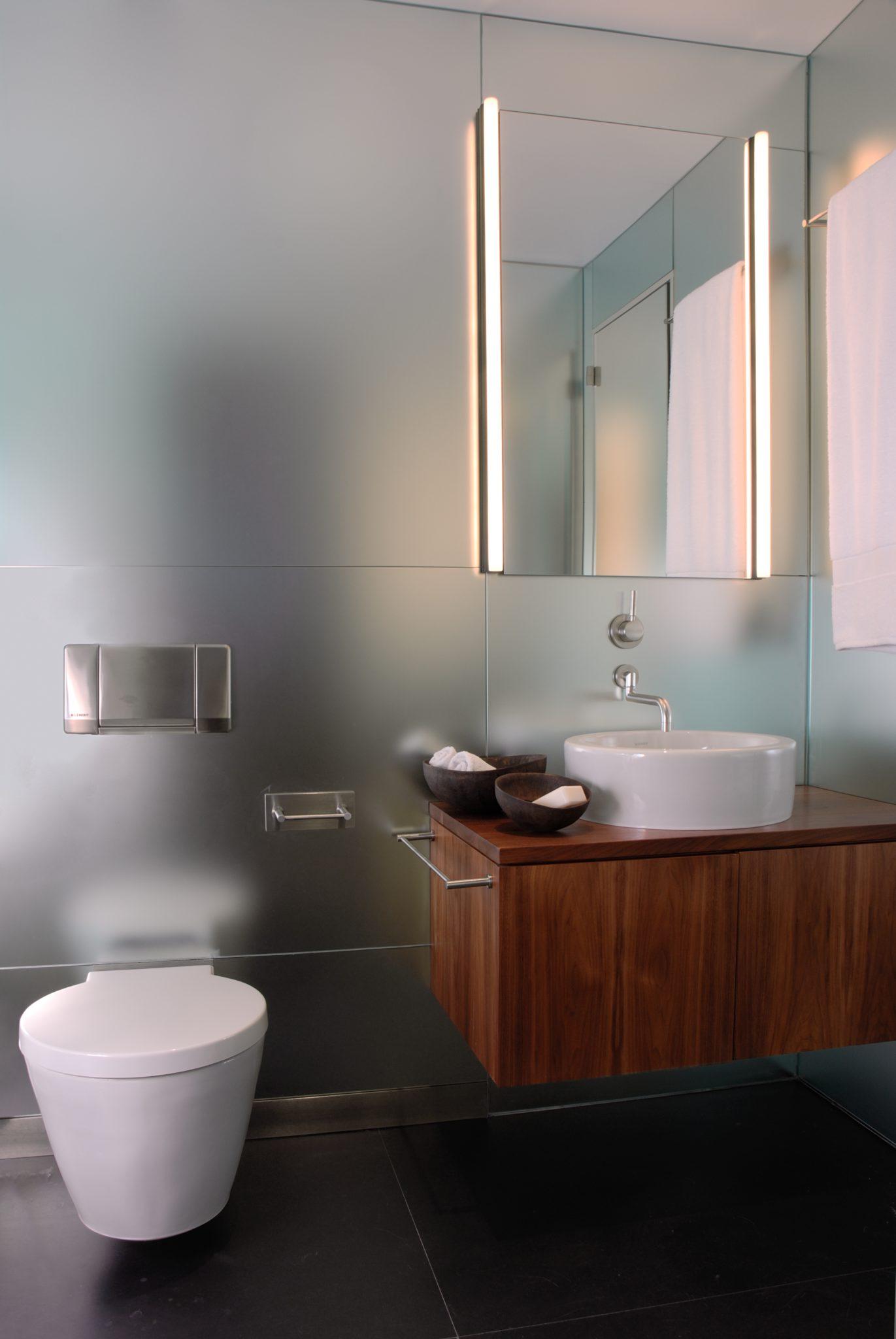 East Hampton Guest Bath with custom mirror walls by Apsara Interior Design