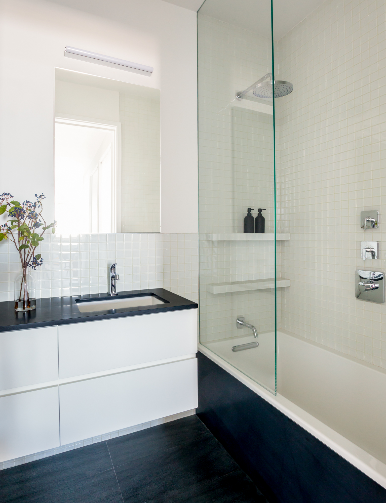 Park Slope guest bath with slate tiled flooring by Atelier Armbruster