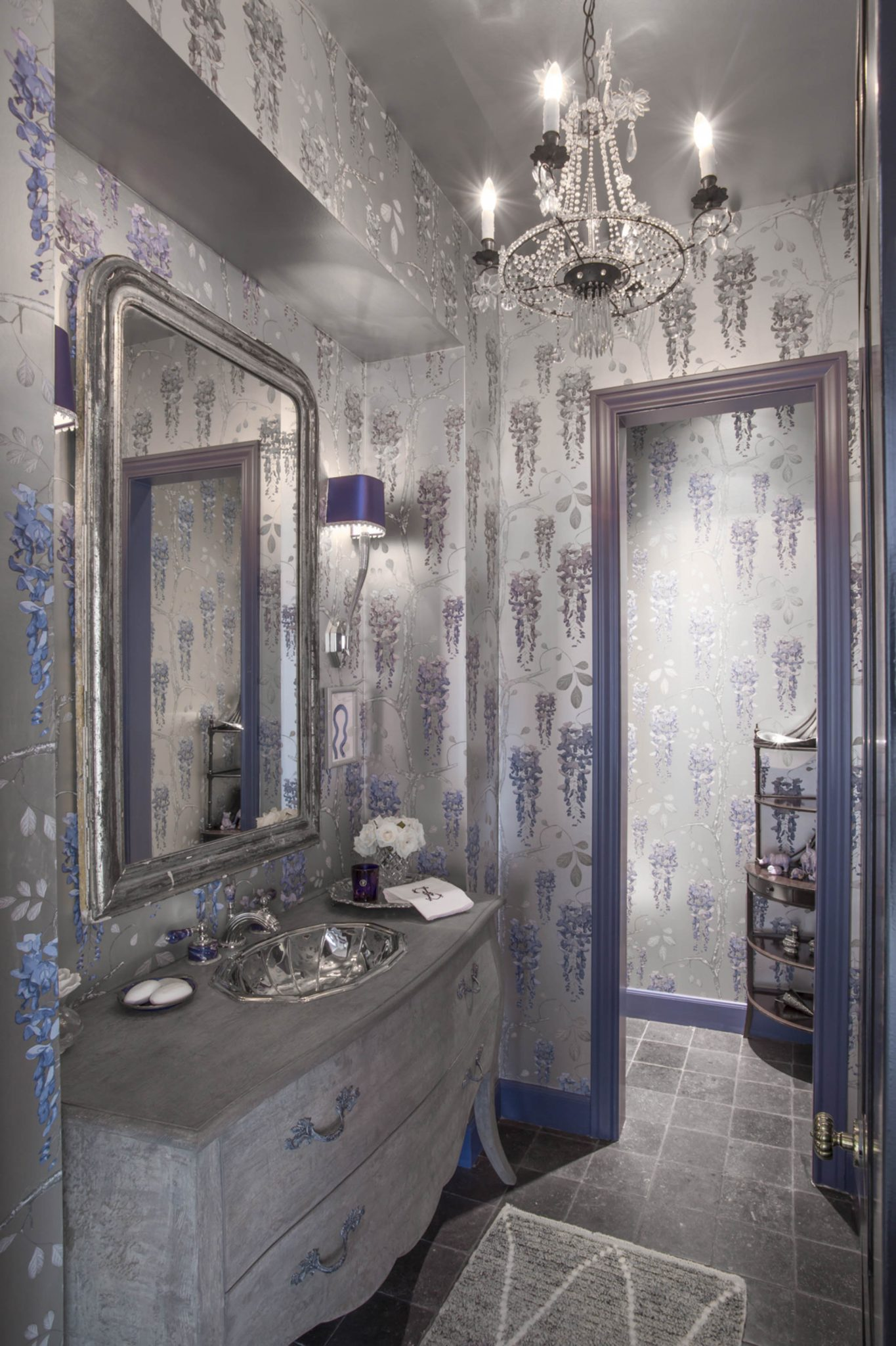Dramatic powder room- rich blue tones, metallic wallpaper & lapis faucet by Nicole Zarr & Associates.