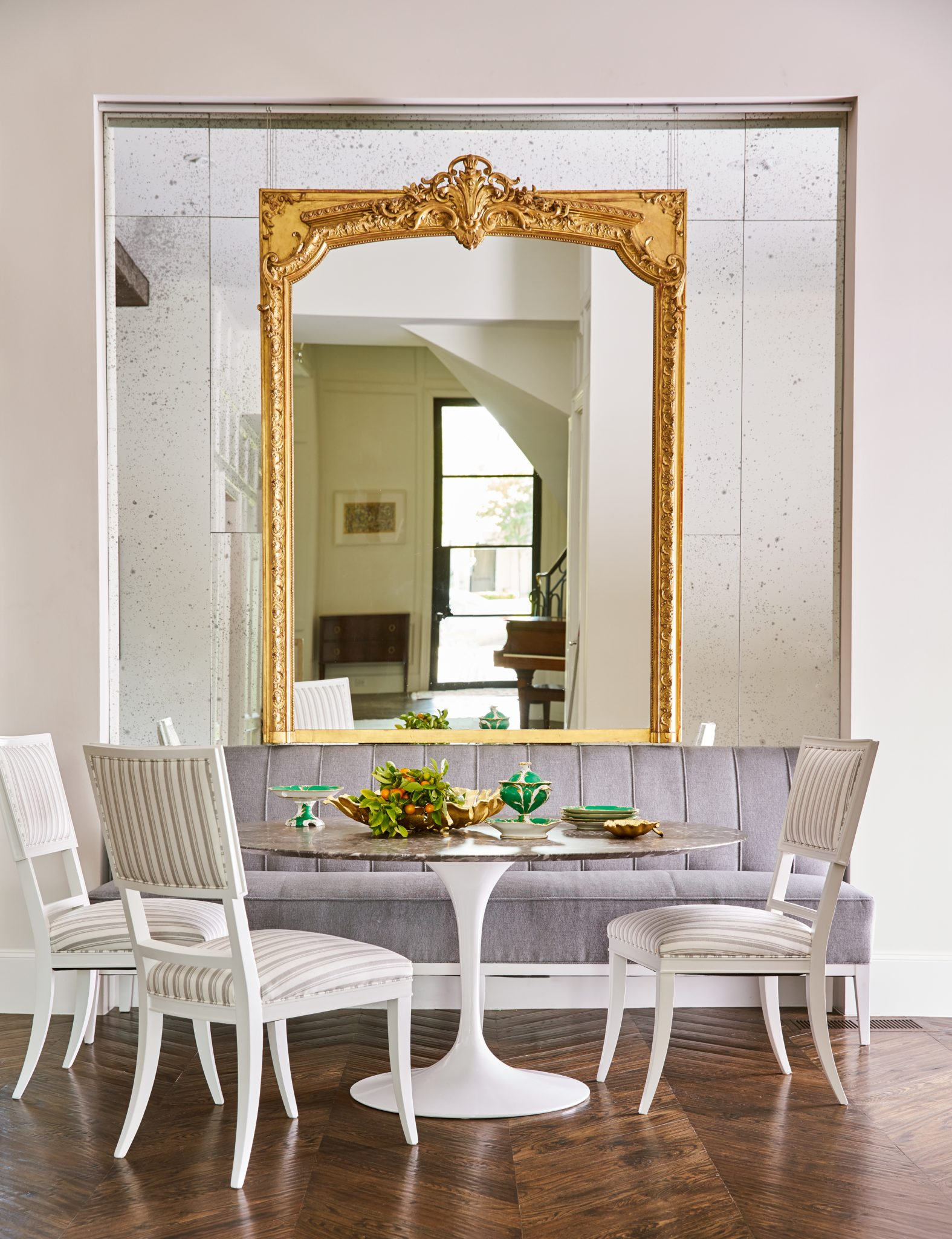 Breakfast Nook with Anique Mirror Feature by Denise McGaha Interiors