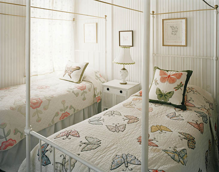 Wisconsin Lake Home with Farmhouse Style: Butterfly Quilts & Four Post Twin Beds by Bardes Interiors