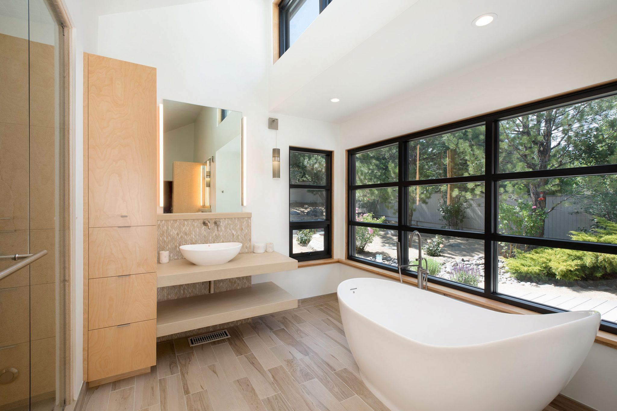 """Light Woods in Bathrooms   In a bath, simplicity is key. Light woodscan soften and brighten a bathroom design, usheringin natural materials without slipping backward into the heavy wood vanities of earlier decades, and helping to build a relaxing, immersive oasis.""""Today's bathroom is created for a relaxing experience in a peaceful atmosphere: planned for a ritual,"""" says Marcio Decker ofAspen Leaf Interiors, Incin Truckee, California.""""Light woods and light surfaces with natural textures and grain, lime-washed or cerused, will add to the visual portion of the experience. Using rift-cut white oak, bleached walnut, birch, and other light-toned woods in a bathroom application can magnify smaller spaces, bounce desired light back into the room, and render an easy, simple ambience."""""""