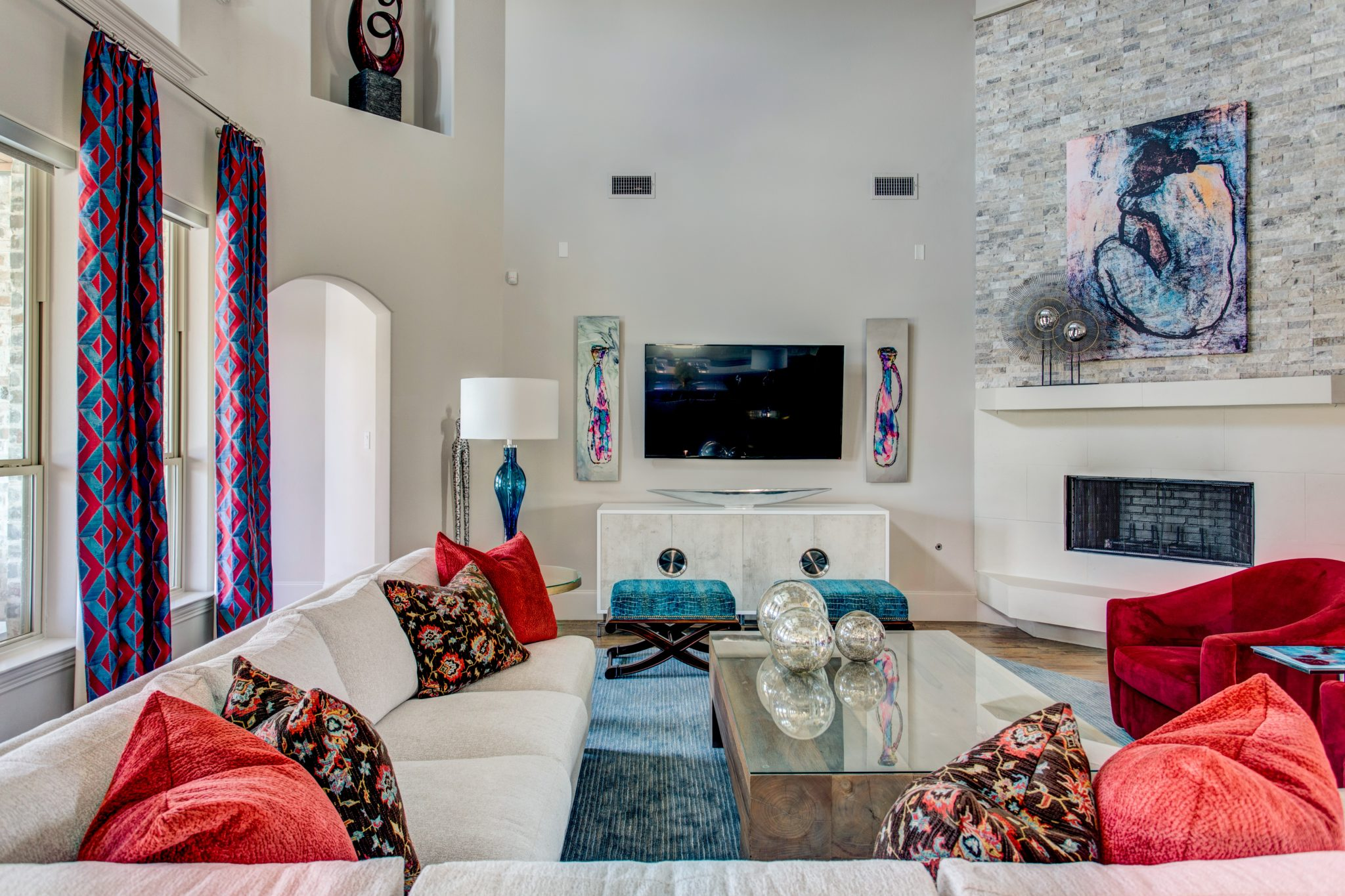 Two focal points blend smoothly together in this fun family room. by Wesley-Wayne Interiors