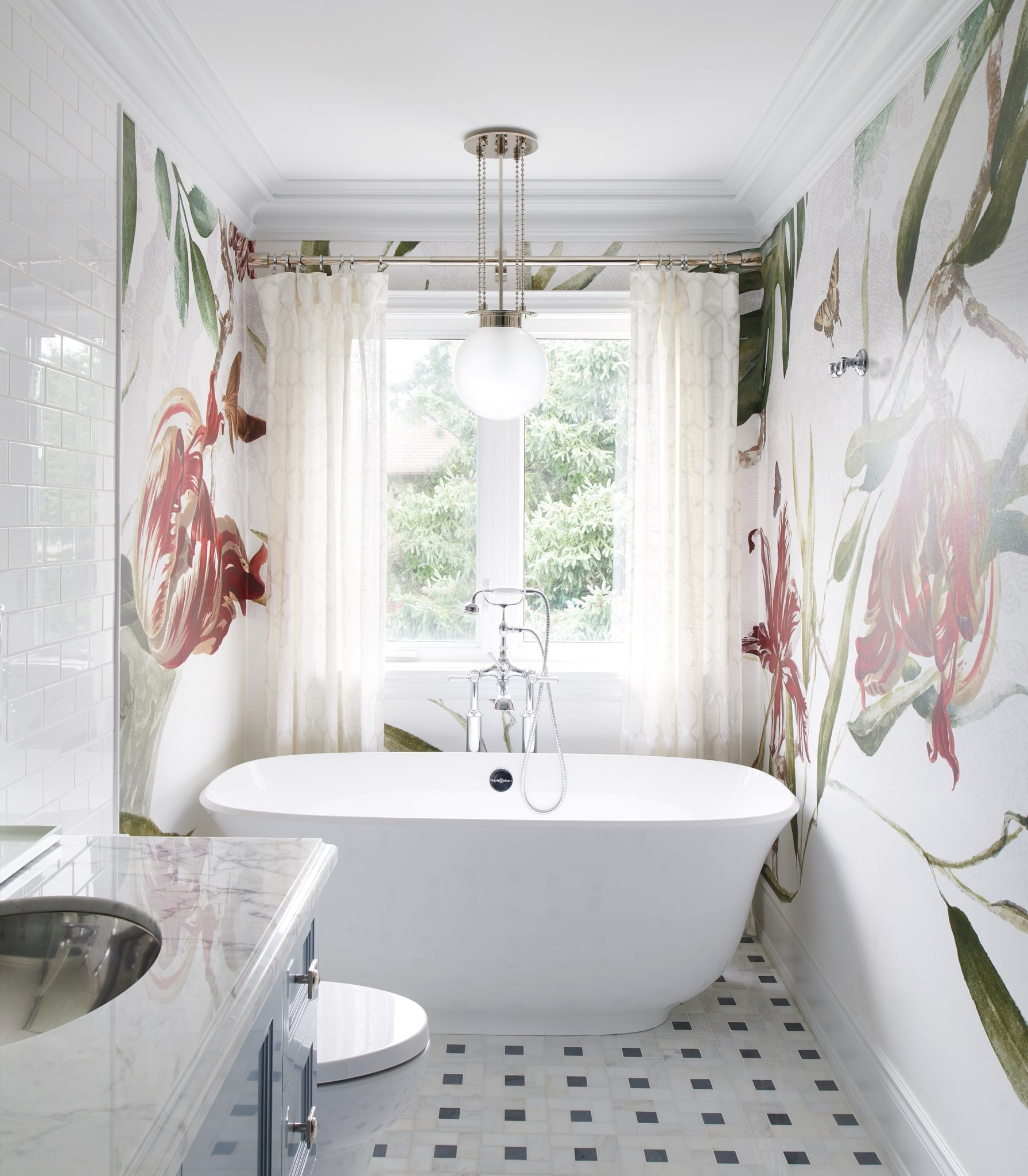 "Try Out Dramatic Drapery in the Bathroom   In the bathroom, dramatic, floor-length drapery can shut out the outside world when privacy is necessary, and open up to all incoming light when it's not. ""I love designing window treatments for those bathrooms with large windows and lots of daylight,"" says Svetlana Tryaskina, owner of Estee Design in Toronto. ""If space allows, I do floor-to-ceiling panels, using sheer linen or cotton fabrics, that work best in humid conditions. Adding a delicate trim to the panels always adds a luxurious feel to space."""