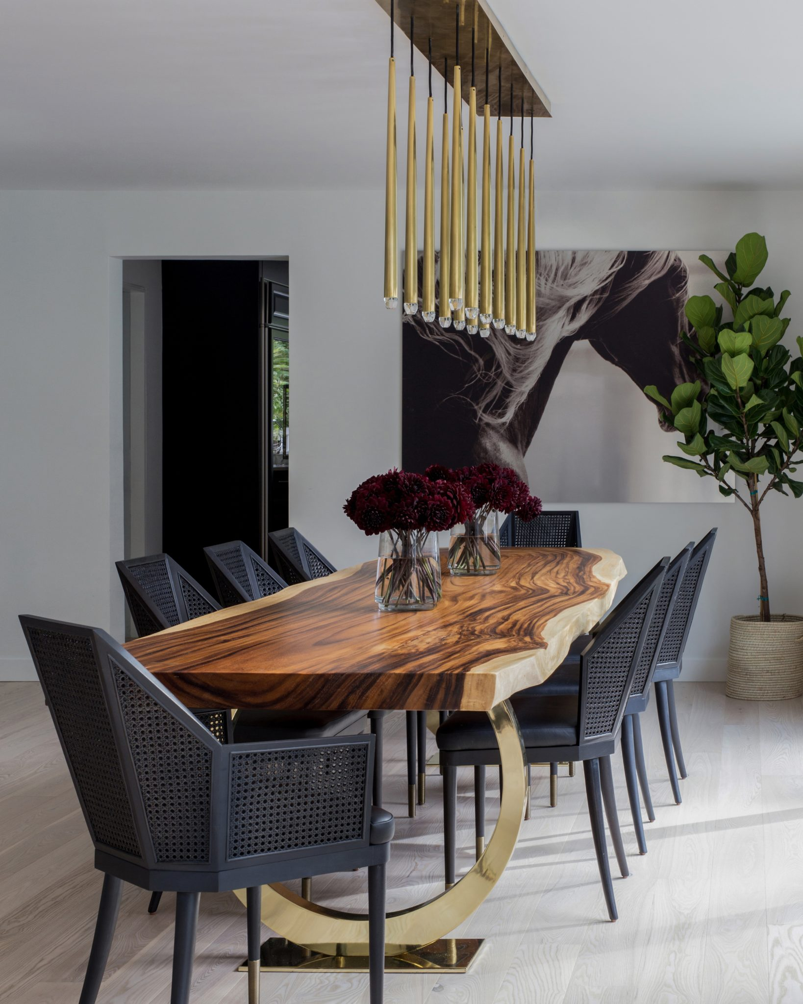 """10. Shop Custom Furnishings   Ensure that your space is unlike any other when you use custom furnishings. A one-of-a-kind table or unique dining chairs will help a dining room stand out.Thecustom, live-edge wood table is the focal point ofthis space. """"The floor plan of this house is very open and the dining table is truly in the heart of the home,"""" says Lisa Hershman of Abaca Interiors. """"The intention here was to meld the husband's love of organic materials with the wife's penchant for glam. The live-edge Chamcha wood slab and brass legs provided a contrast that united both their styles and truly made the piece feel unique to the home."""""""