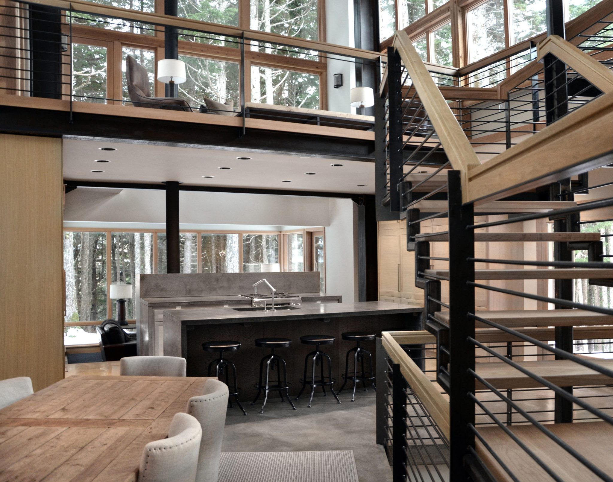Alaska vacation home - open floor plan dining and kitchen area by Nicholas Moriarty Interiors