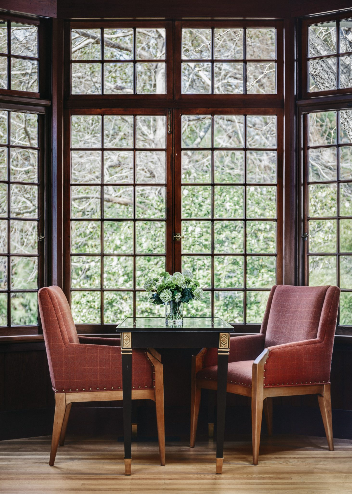 The elegant arm chairs and game table are from Hickory Chair.