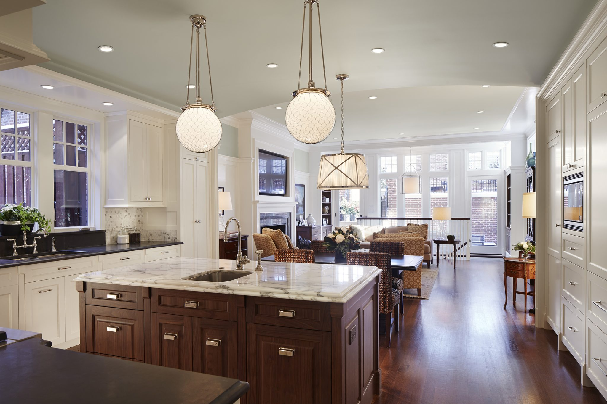 Transitional open kitchen/family room concept by bba ARCHITECTS