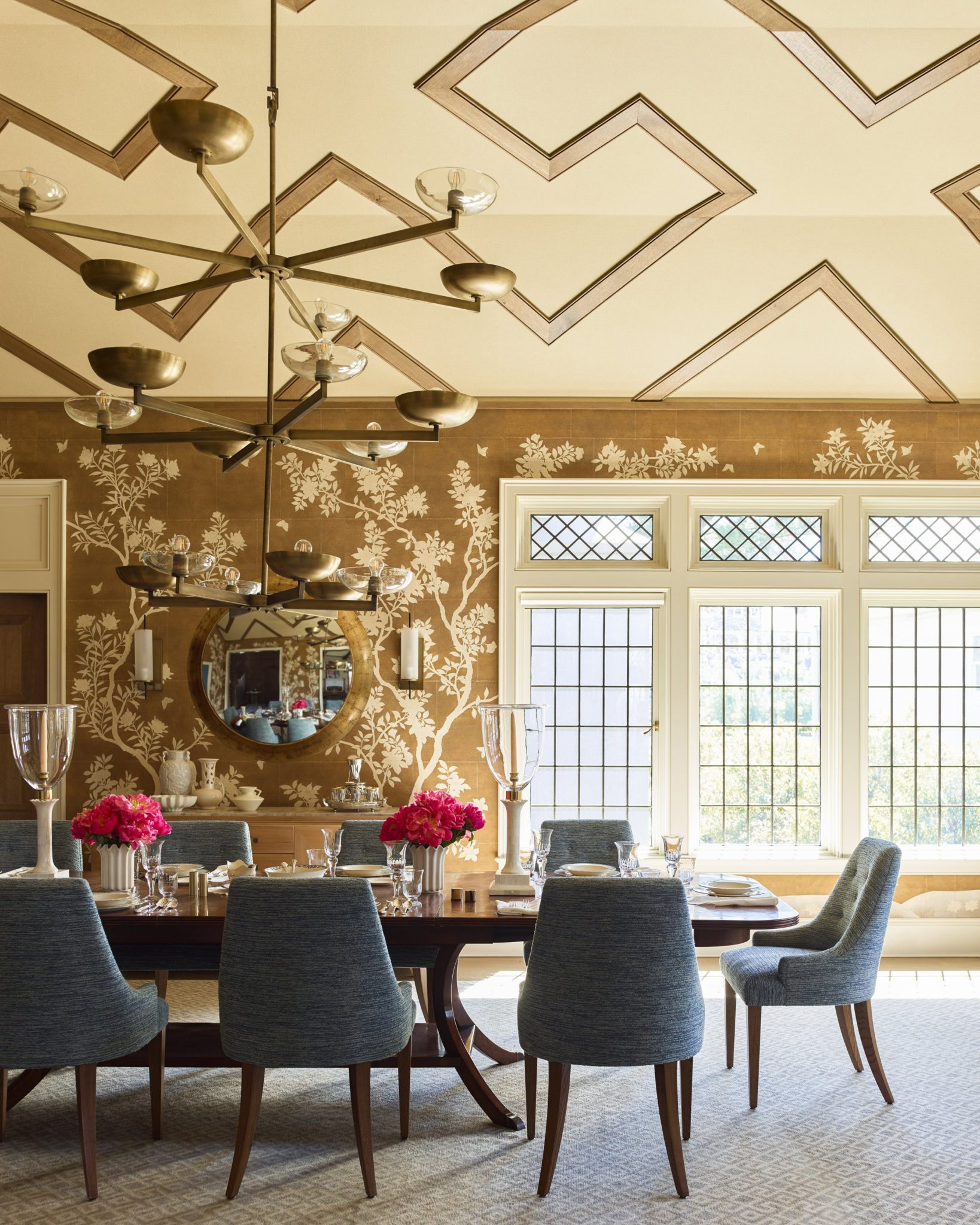 """4. Create a Conversation Starter   Design a space that draws intrigue and promotes conversation among guests, whether it's with unique artwork, bold wallpaper, or custom furnishings.""""Consider what is going to spark great conversation,"""" says Gideon Mendelson, founder of the Mendelson Group. """"The uniqueness of this room partly comes from how we handled the faceted ceiling.""""The team uniquely arranged paneling on the ceiling, adding texture and color to the space. Inspired by the pattern in the rug, Mendelson says that the idea to create the one-of-a-kindceiling came to him organically. """"We were looking at textiles while working on the architecture of the rooms, andwe always like the looks of a repetition of forms at different scales,"""" he says."""