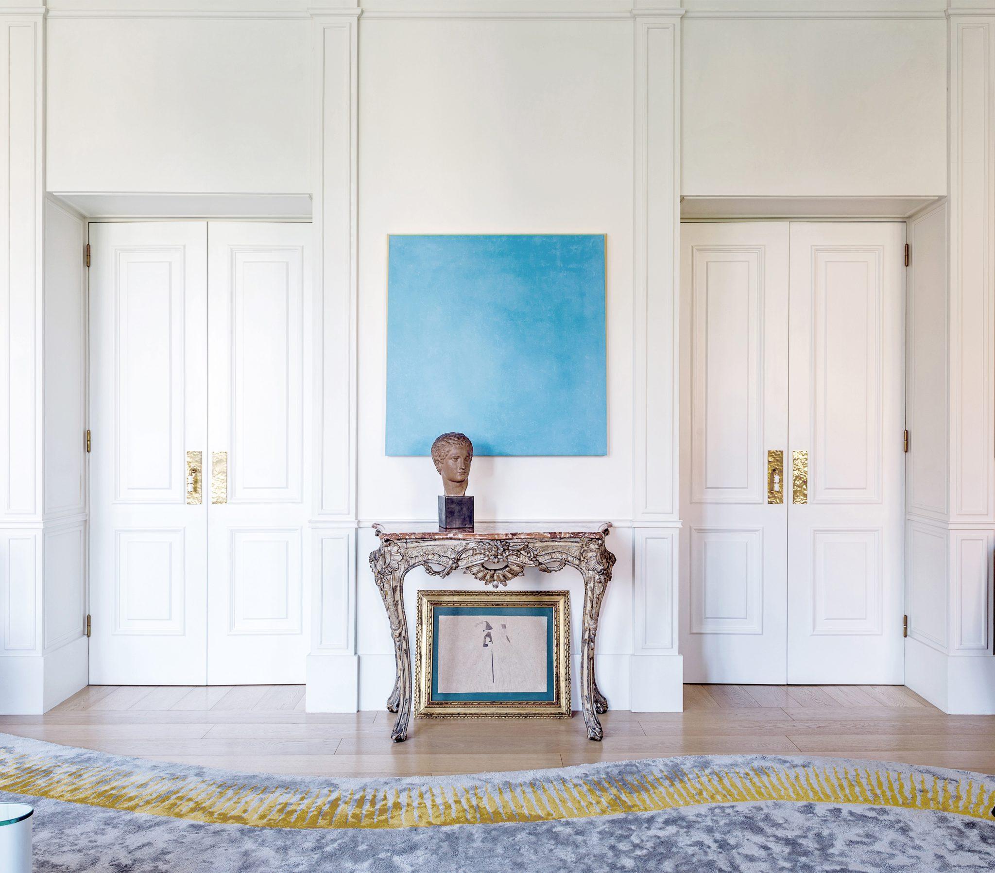 In Salvagni's living room in Rome, a Louis XV console is juxtaposed witha 2011 painting by Ettore Spalletti, Una giornata di sole e oro.