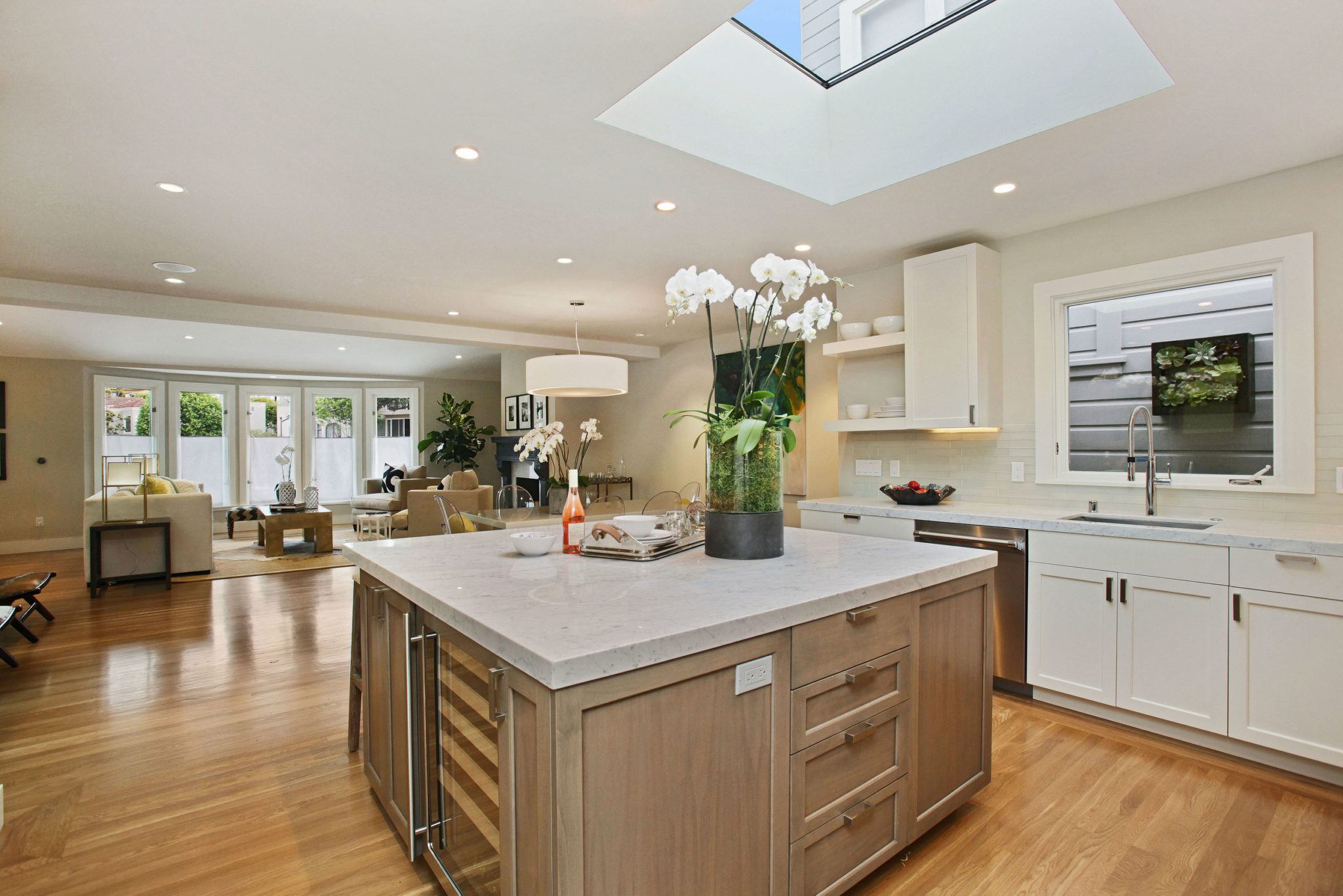Kitchen and family room with open concept and hardwood floors by bd home