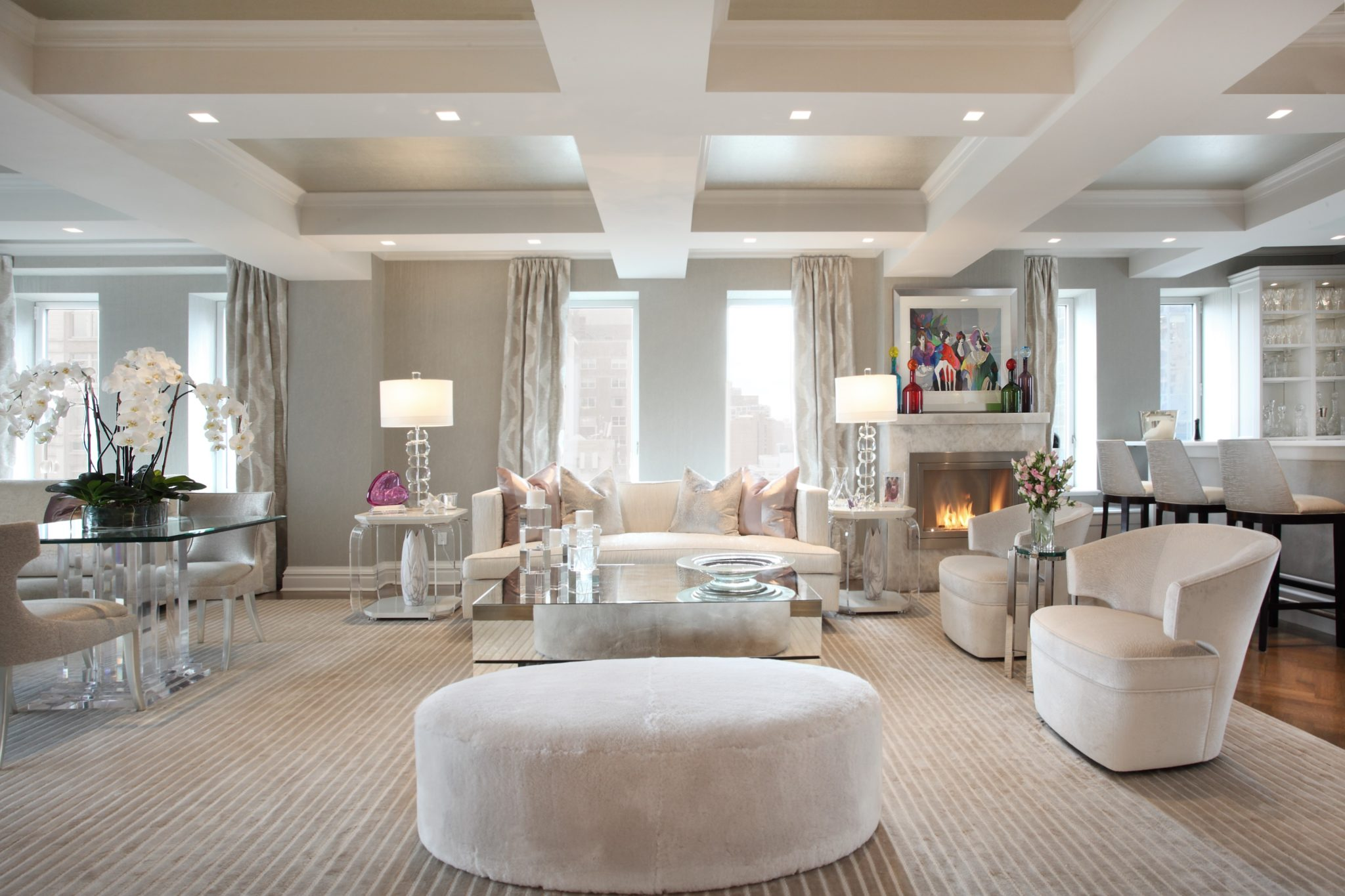 Open living room in spectacular penthouse by Patricia Bonis Interiors