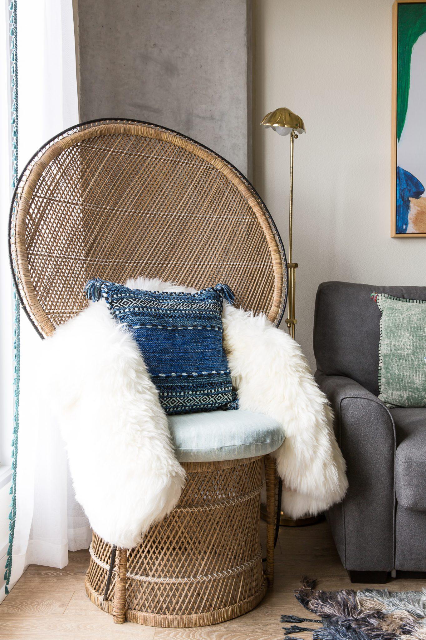 Woven Peacock Chair + Fur Throw + Navy Pom-Pom Pillow by Maureen Stevens Design