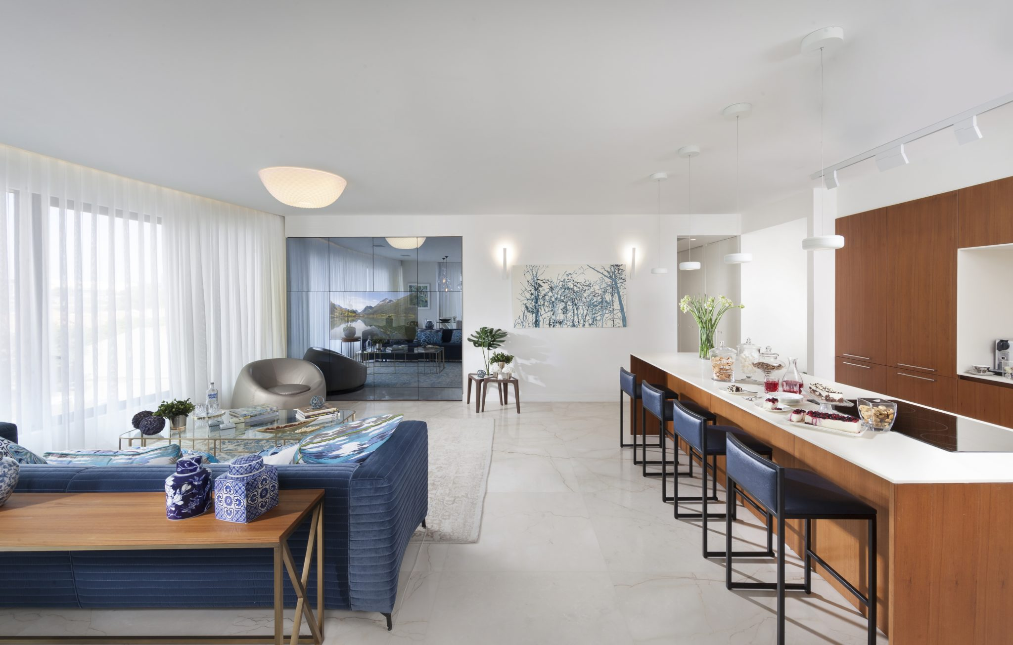 Tel-Aviv ocean-view apartment featuring open space with relaxing cool and warm colors. By Annette Frommer Interior Design