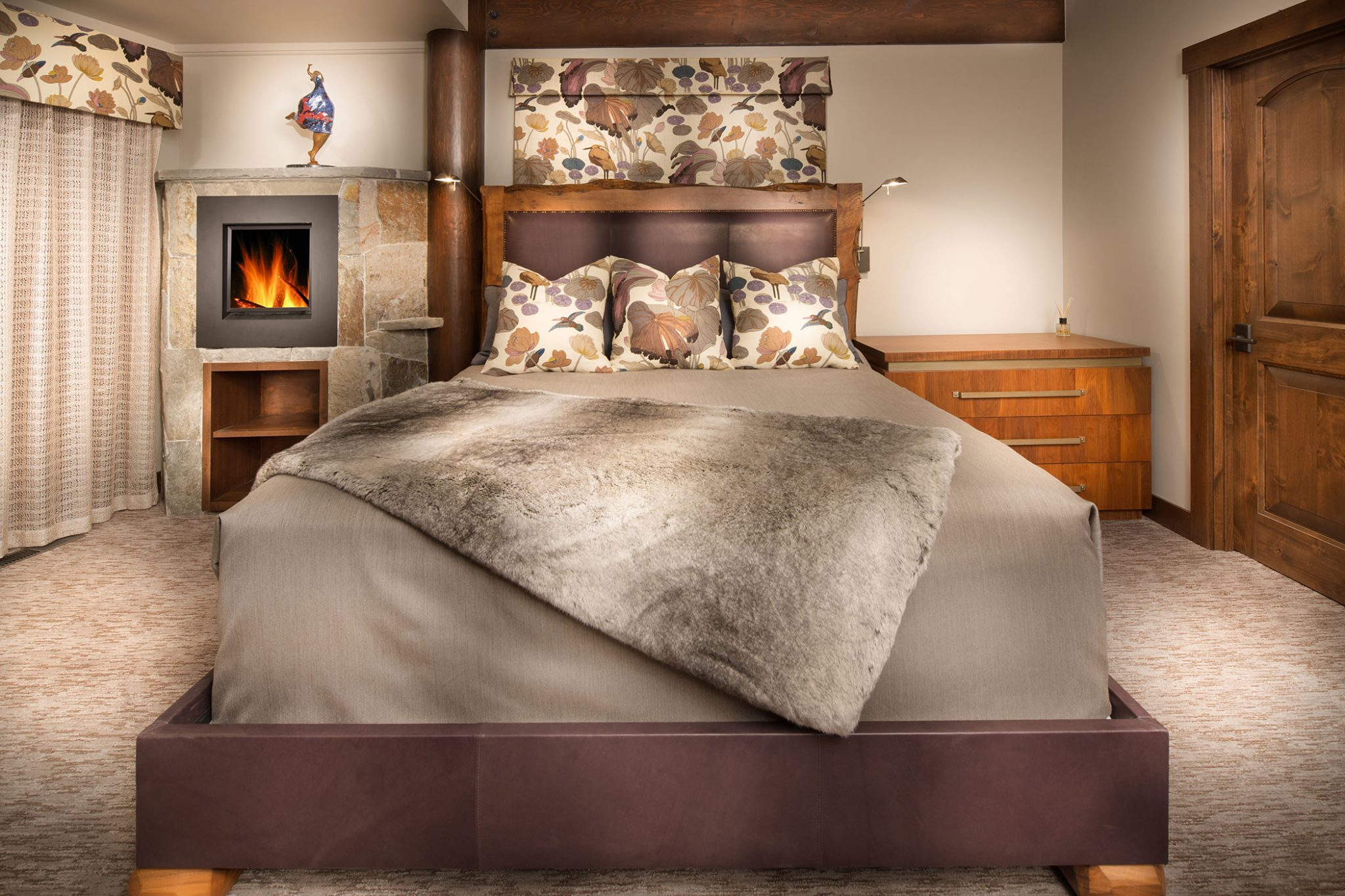 Eclectic Lift, flowery brown bed pillows and window accent and brown fur throw by Aspen Leaf Interiors, Inc.