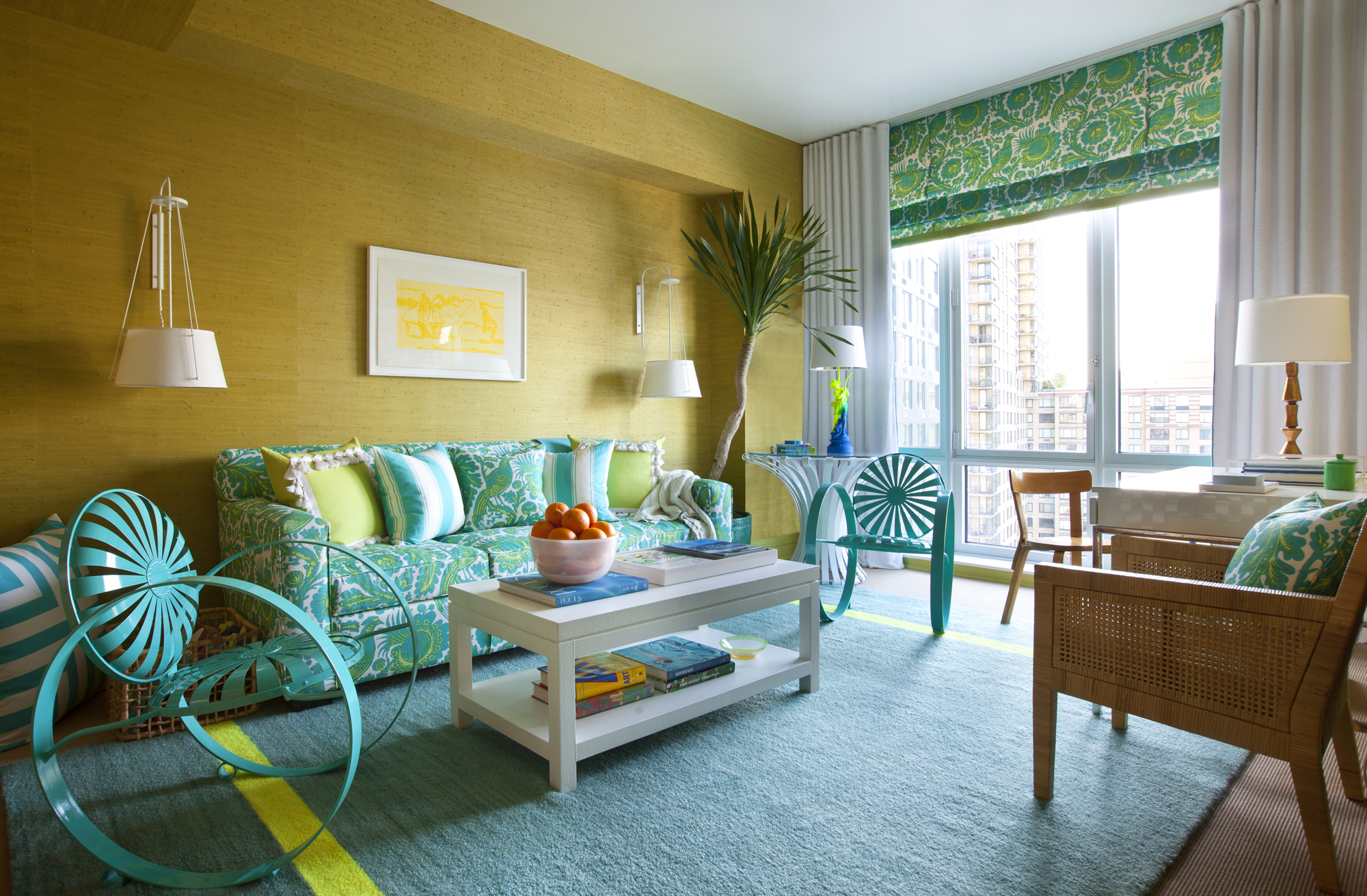 A bright-colored cabana with sunshine yellow textured walls and fun furnishings. By Scott Sanders