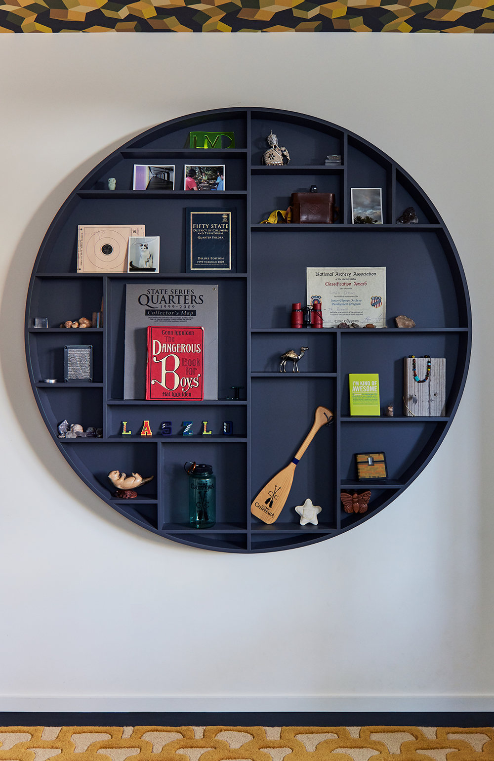 The circular display shelf was custom-made by Nest Building in Pacifica.