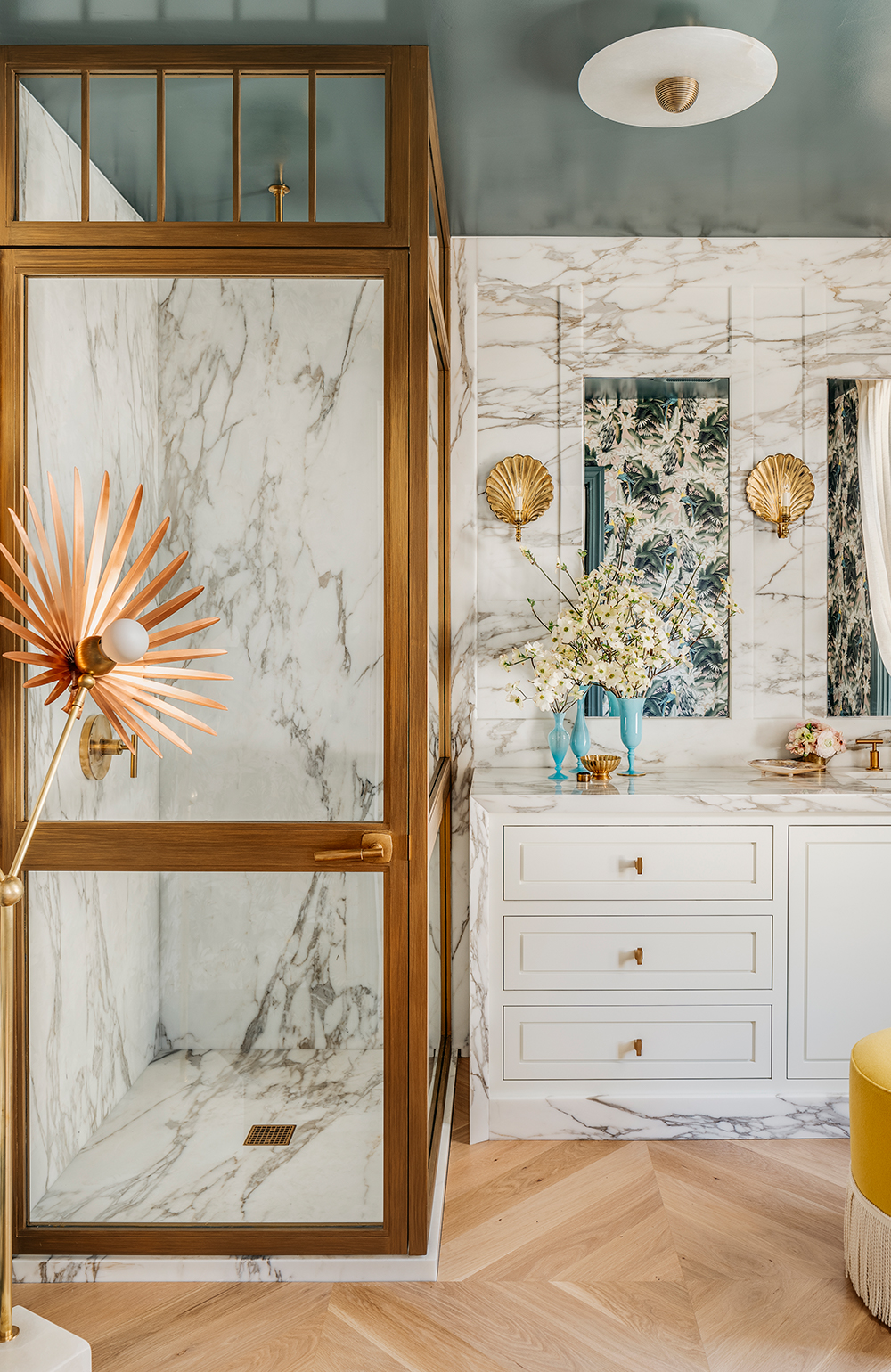 L'Espace Tranquille by Julie Rootes Interiors  Historic Parisian bathrooms provided the inspiration for an Art Deco-style bathroom from Julie Rootes Interiors. The light switches are from Forbes & Lomax, and the sconces are from Soane Britain, while the wallcovering and fringe are from Kneedler|Fauchère.