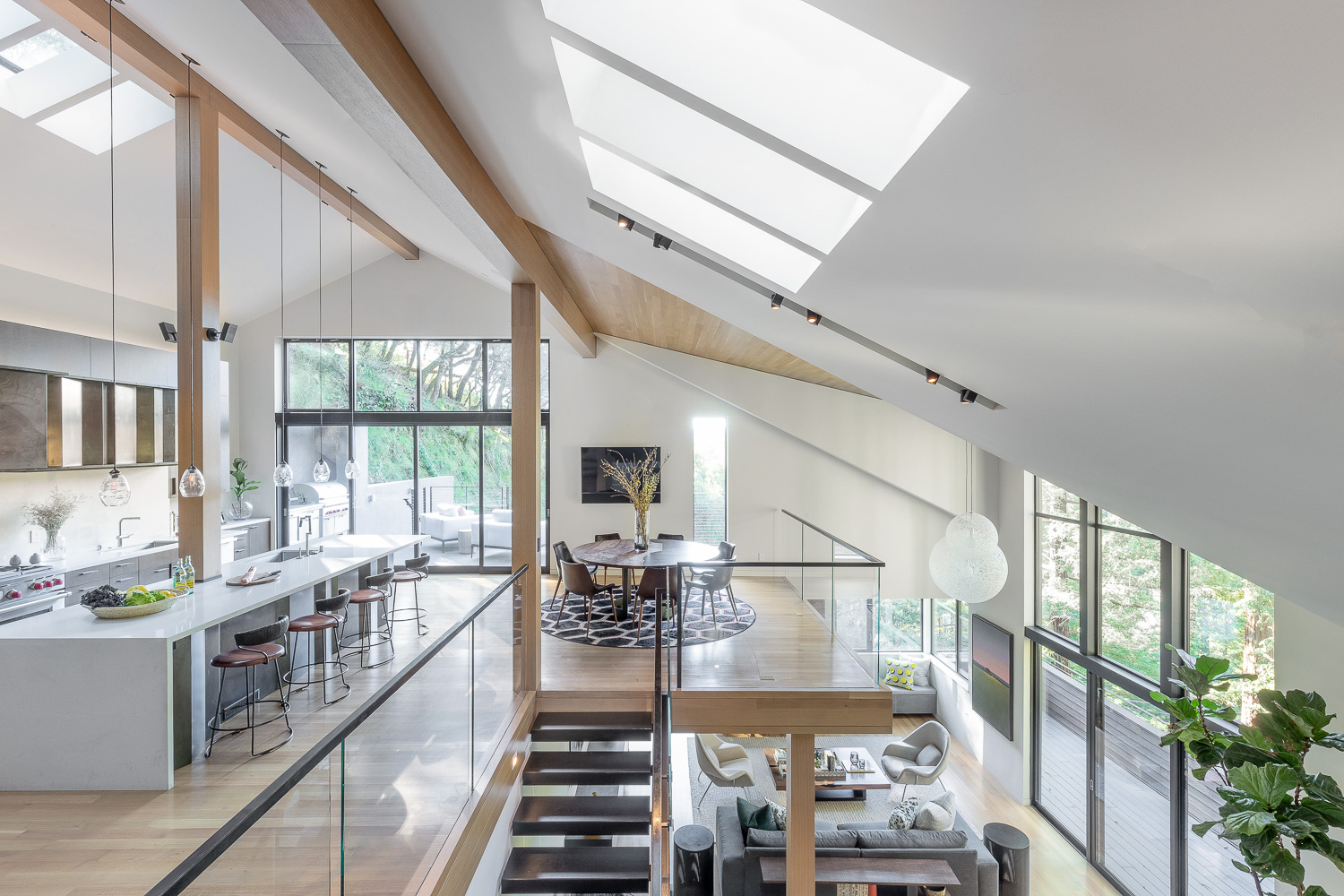 Sky lights usher in plenty of natural light, which filters through the open layout. Parlettepositioned outdoor rooms at either end of the space.