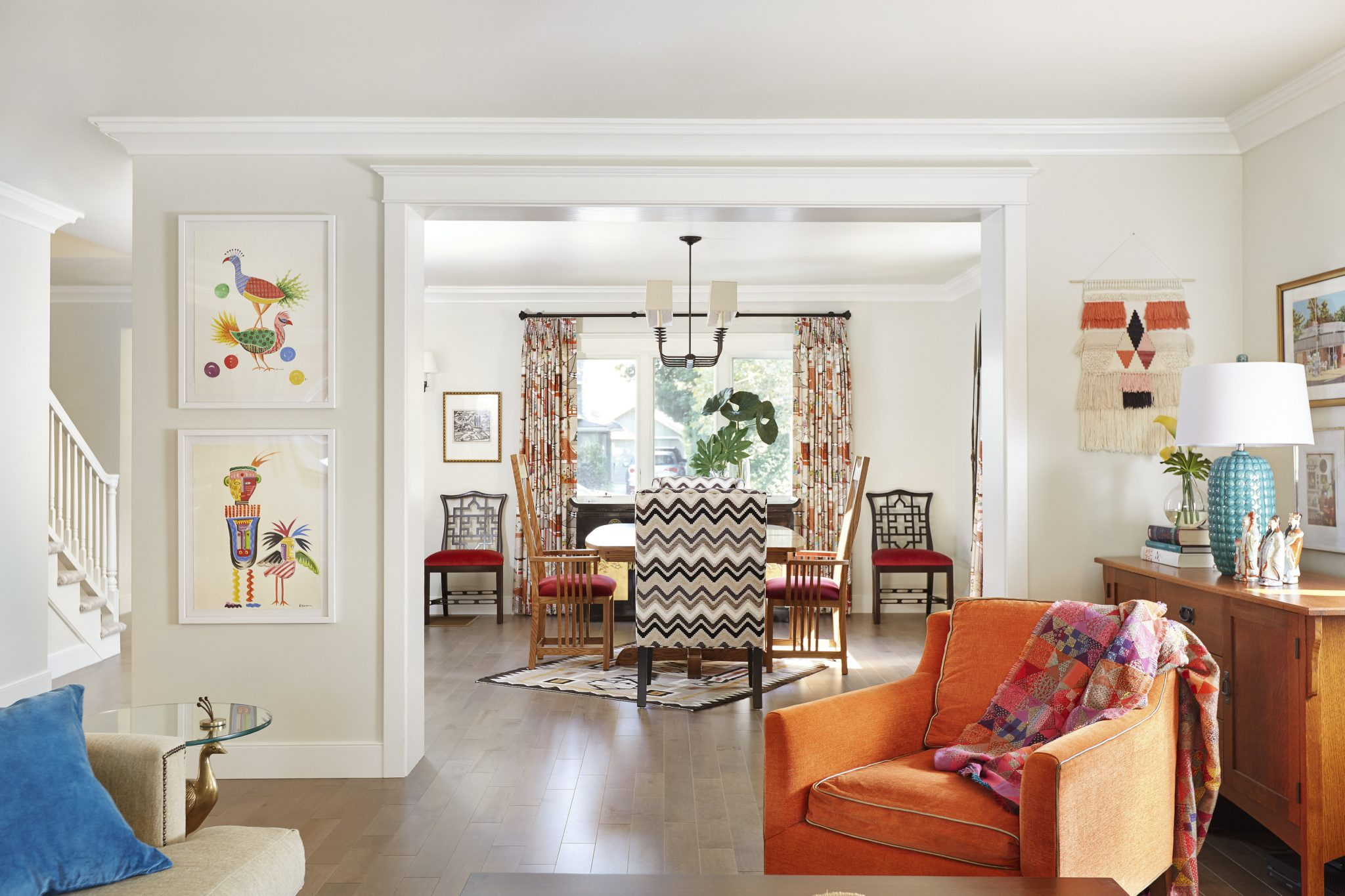 Light andbright open floor plan in an updated craftsman home with pops of color. By PepperJack Interiors