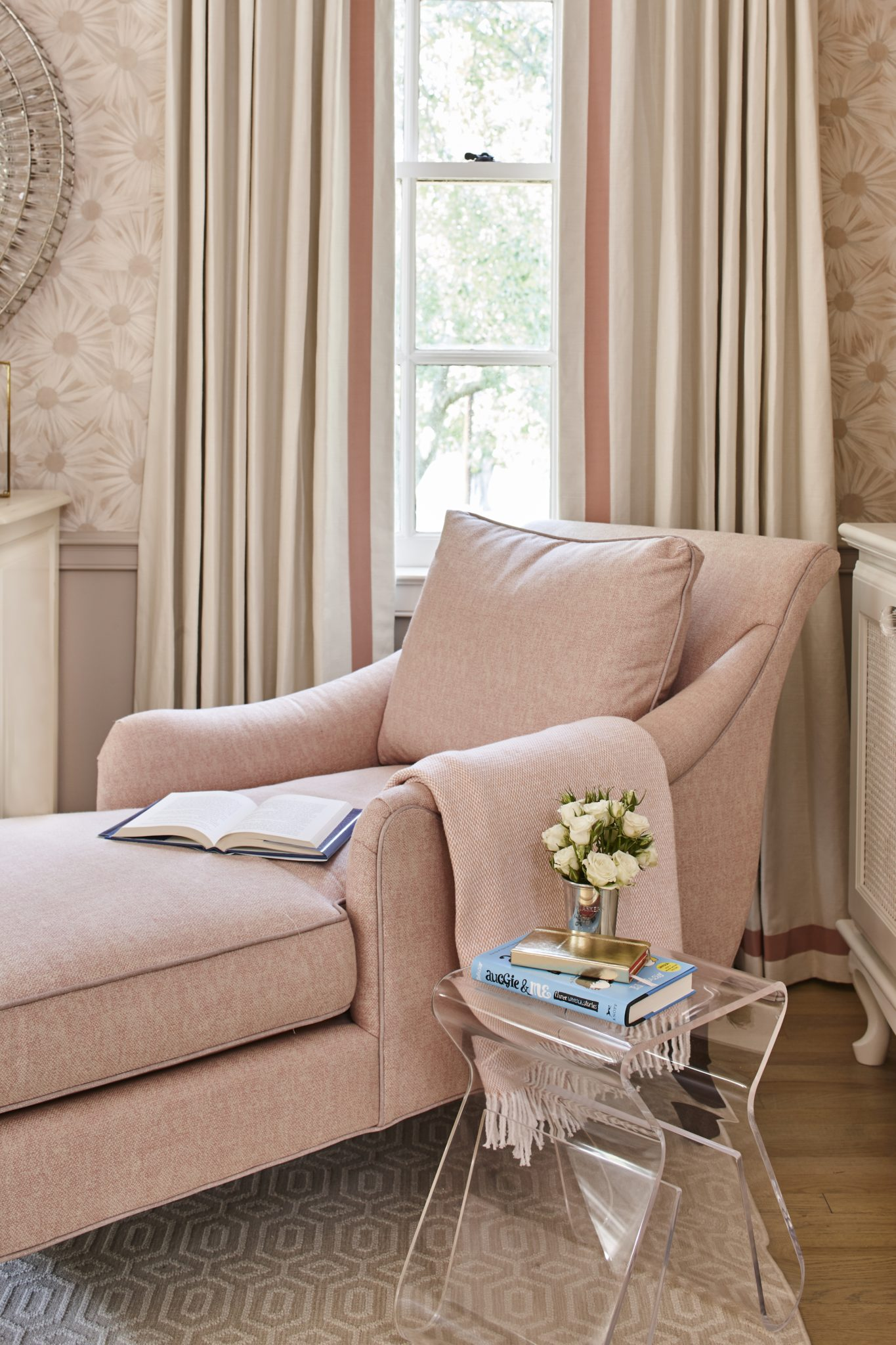 Girl's room with blush chaise lounge chair and soft blush wall covering by Ashley Gilbreath Interior Design