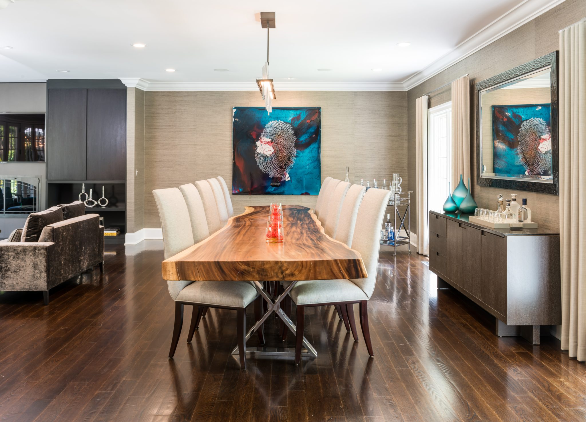 Organic edged dining table in open concept sprawling ranch. By Kim Radovich Interiors