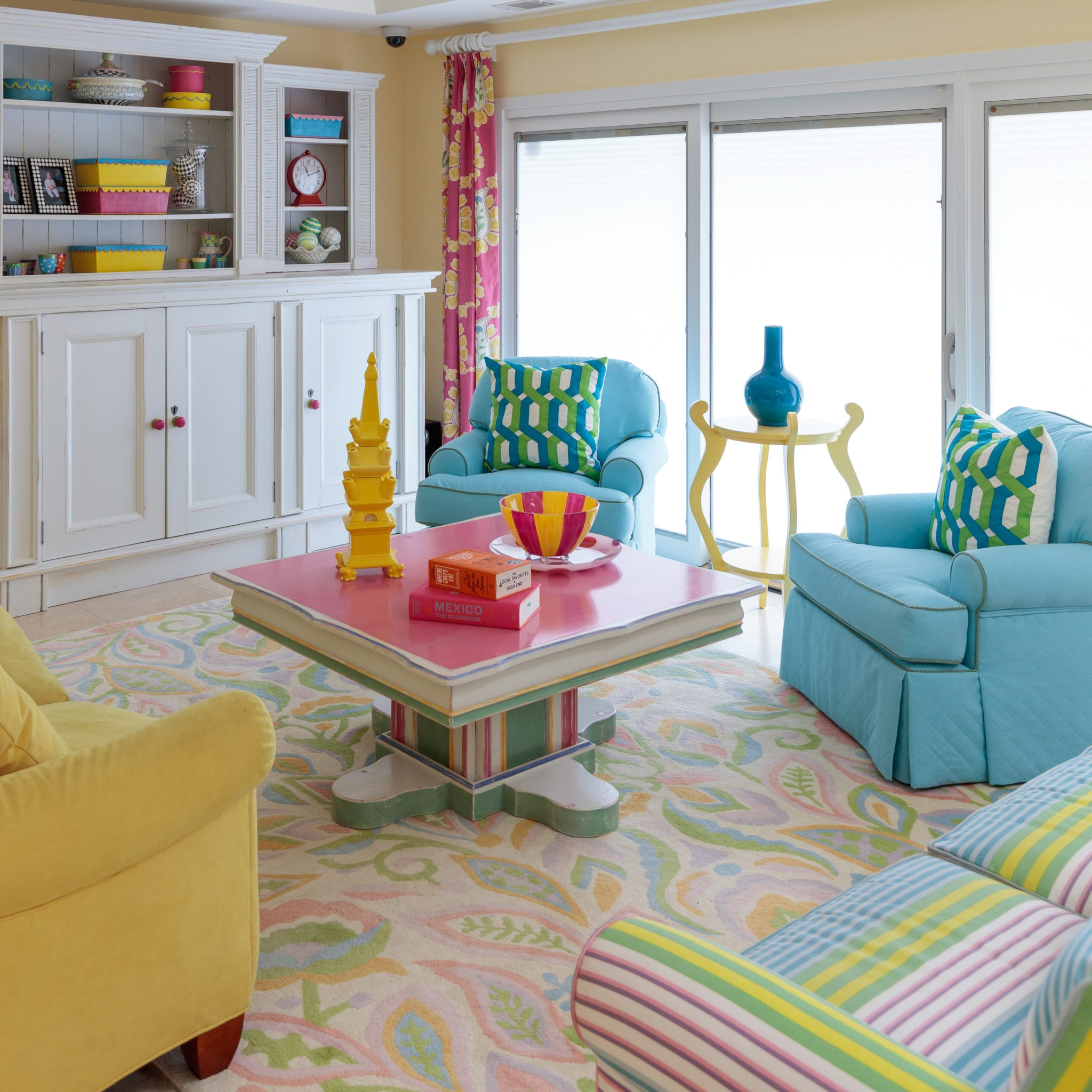 Bold colors and bright whites create an upbeat and lively family room! By J Banks Design