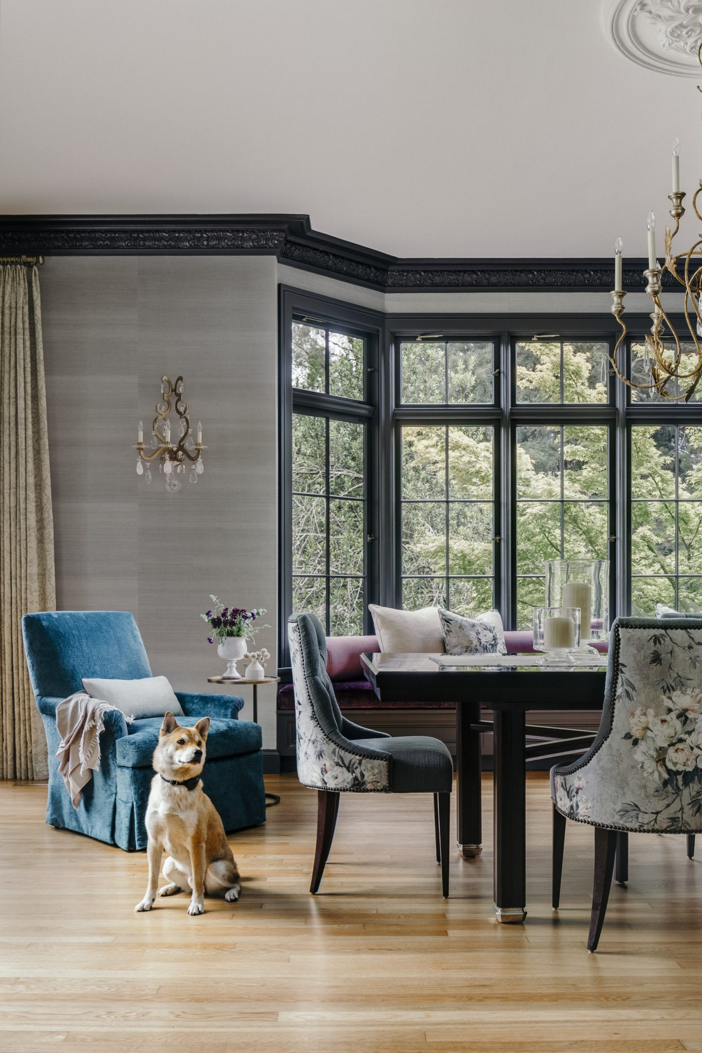 In a cordovan finish, the table is from Century Furniture. Upholstered in fabric from Designers Guild, the dining chairs are from Baker Furniture. The iron wall sconceis from Ralph Lauren Home.