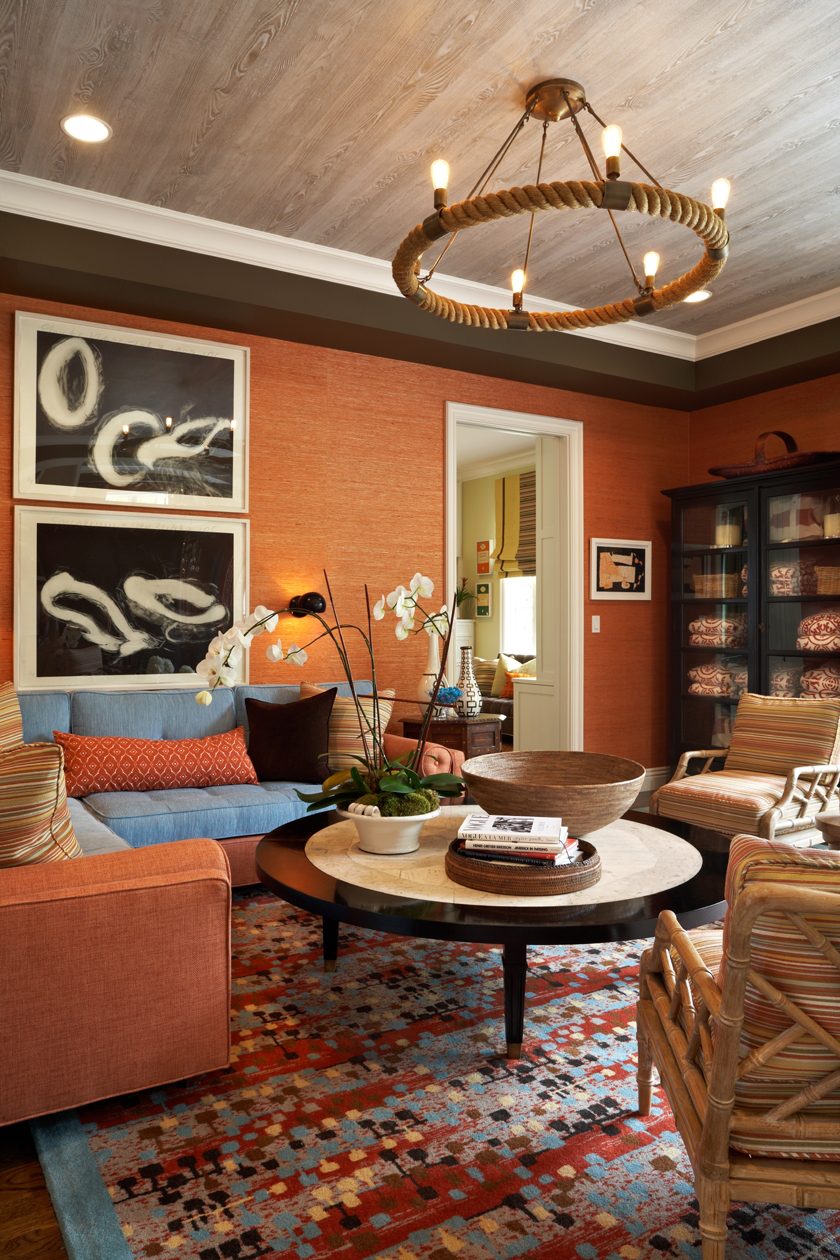 A family room with rope chandelier, custom rug, family-friendly sectional, and artwork by Donald Sultan. By John Willey   Willey Design LLC