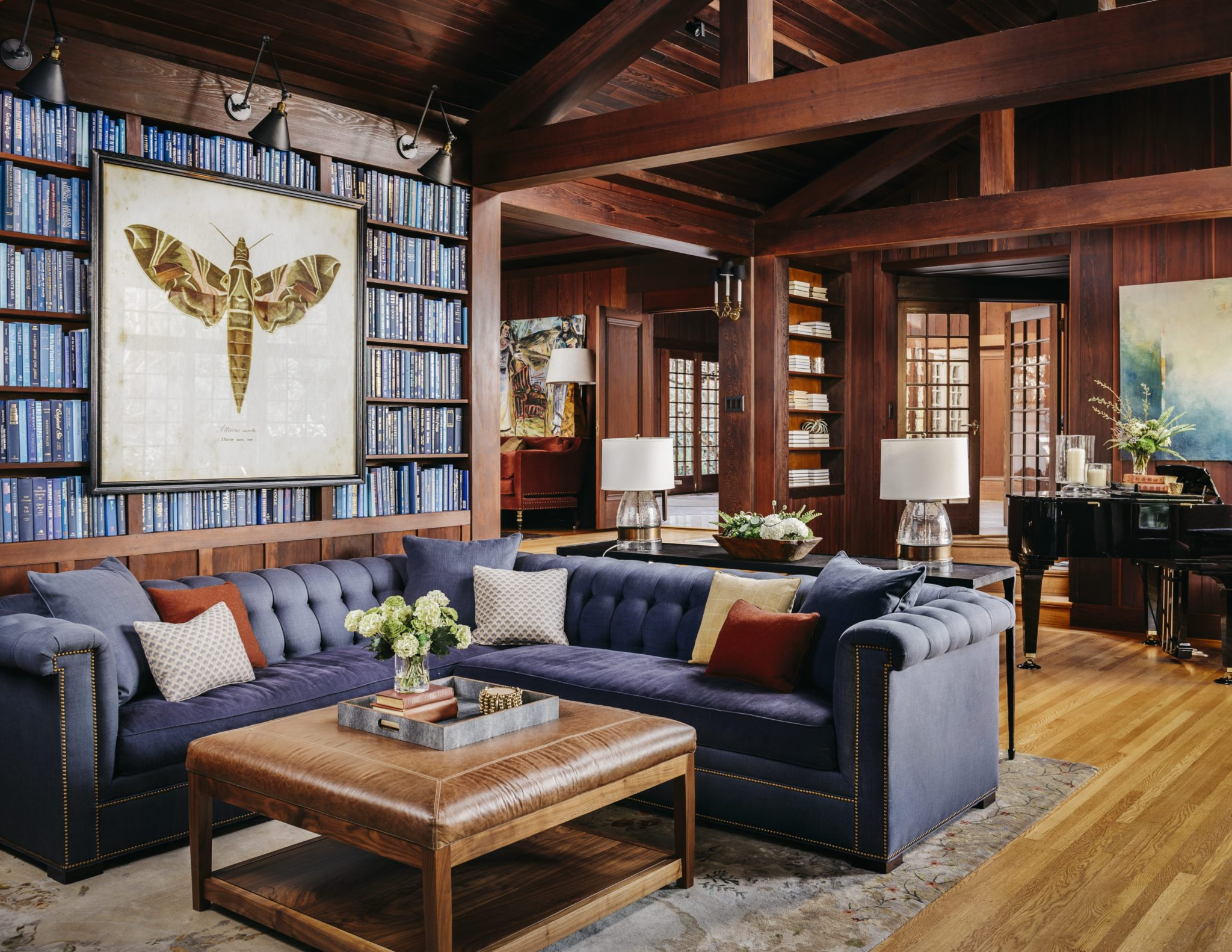 Like the library, the family room is influenced by a traditional European style.