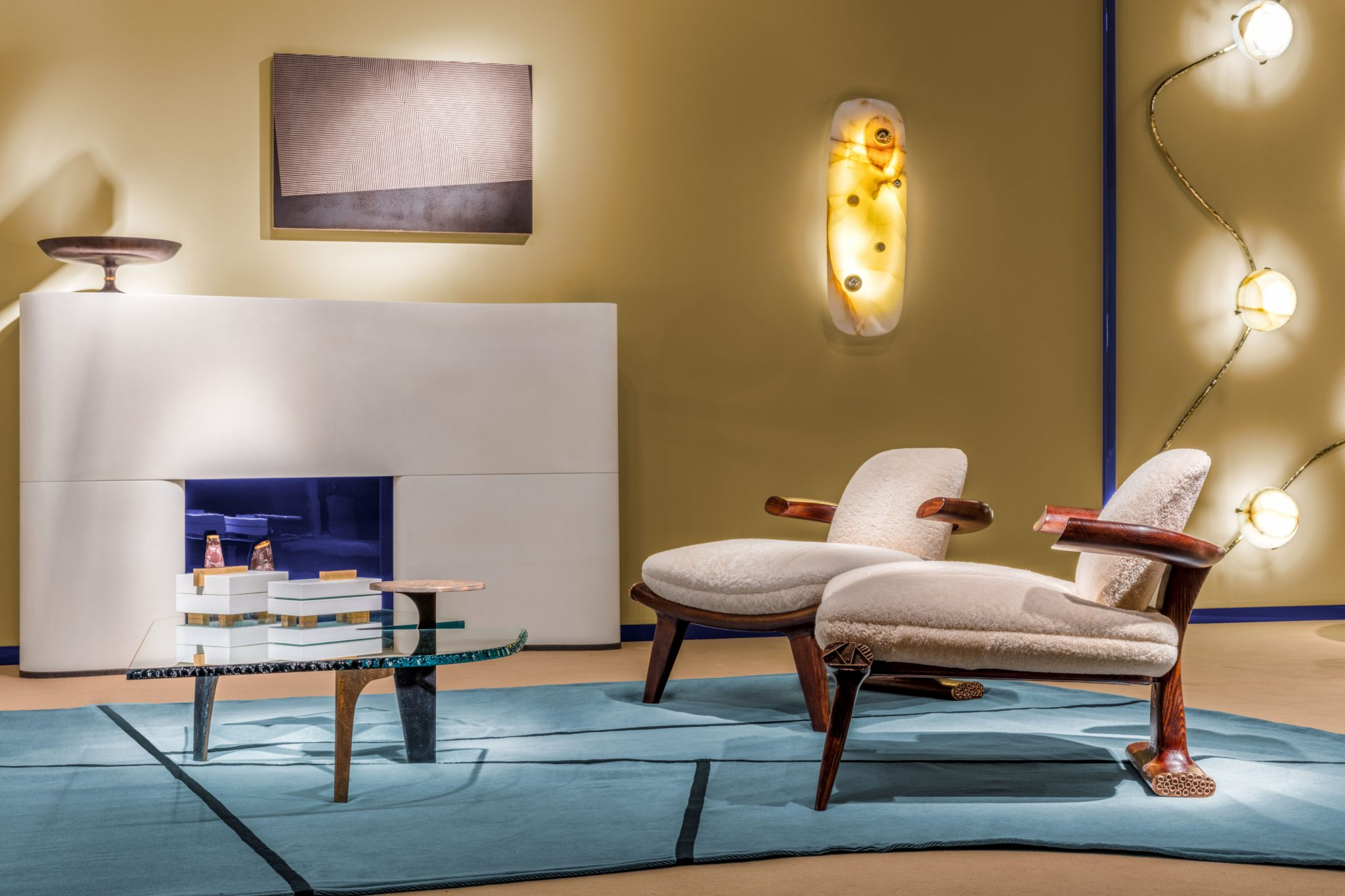 For a living room in Geneva, Salvagni created a customparchment-wrapped fireplace surround which is flanked by a pair of his Pillow Magnum sconces. HisAres coffee tableand Amboseli chairs are placed on a free-formsilk rug.