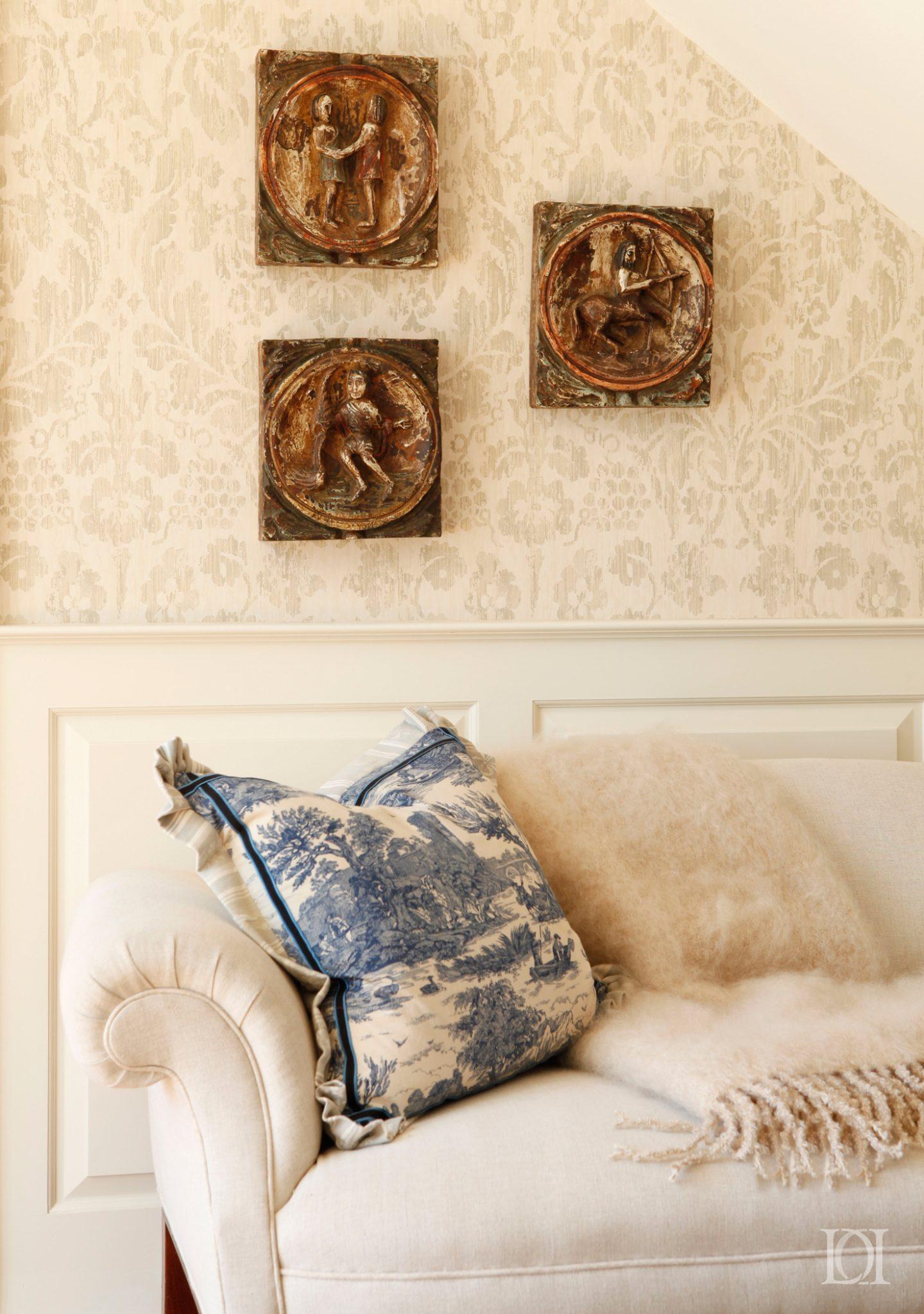 Antique fabric pillows,damask wallpaper, mohair blanket, wainscoting by Deborah Leamann Interior Design