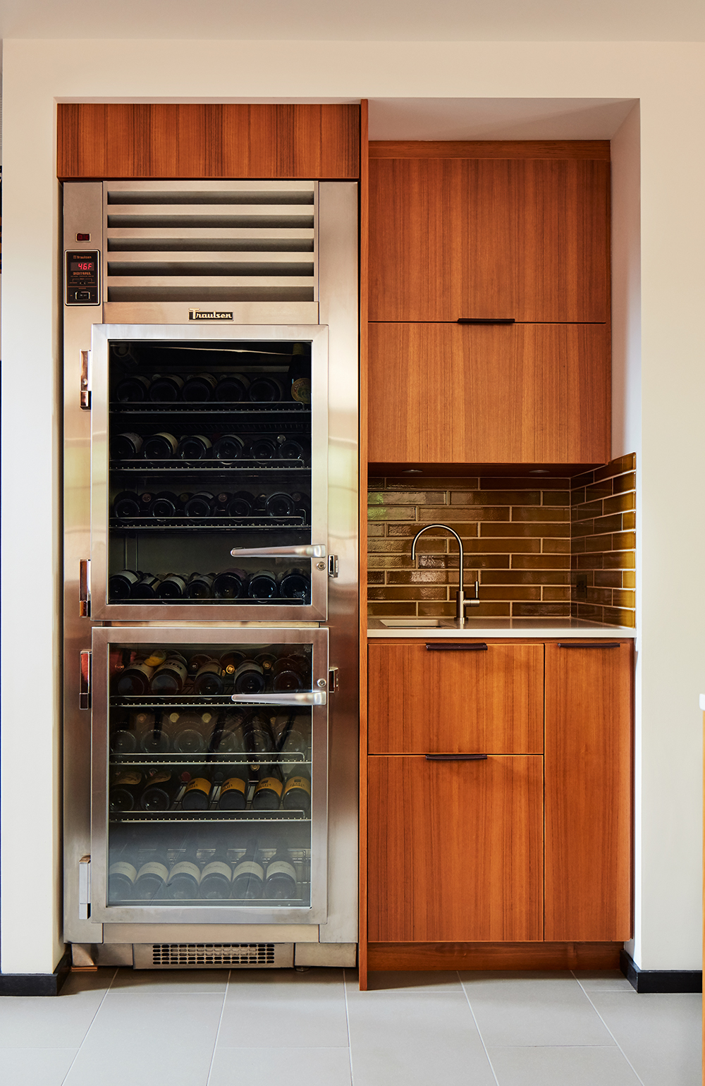 Minimalist faucets from Vola throughout the house keep the aesthetic clean, even in its details. The restaurant-grade wine fridge is from Traulsen.