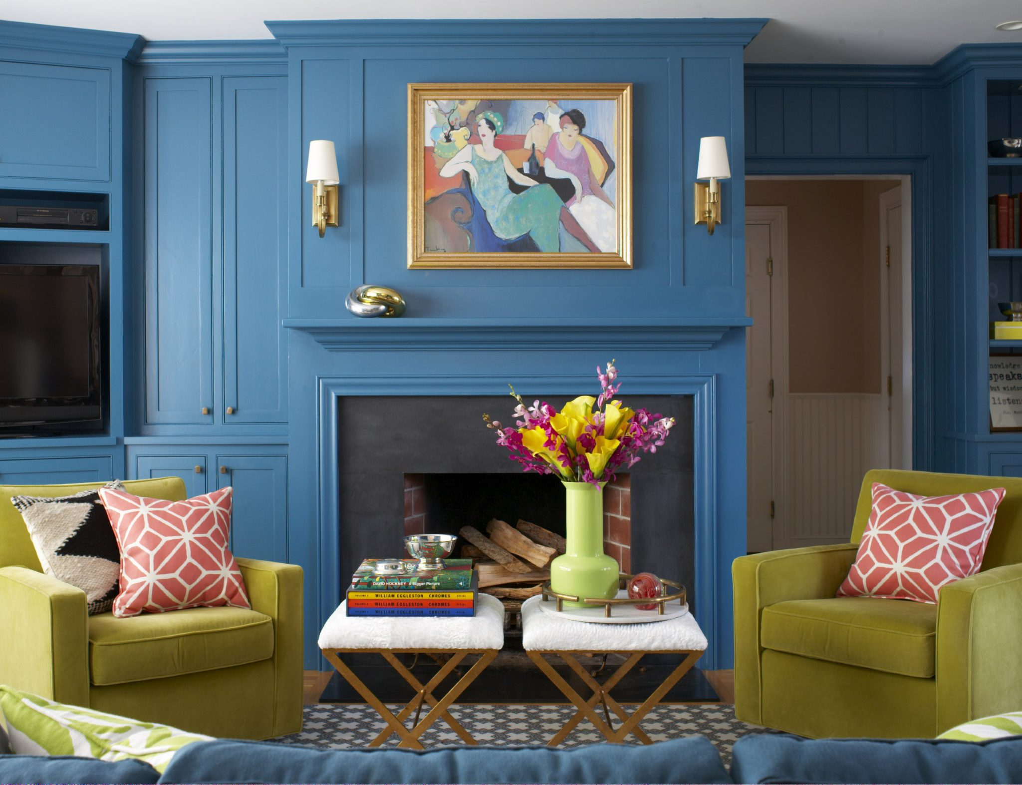 Living Room with Art and Sconces over Fireplace by Liz Caan & Co.