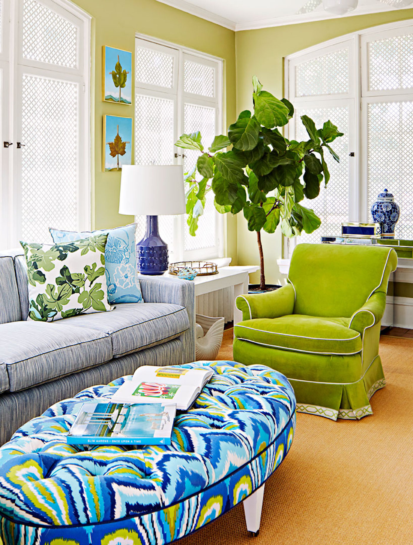 Family Room with Colorful Seating by Amanda Reynal Interiors