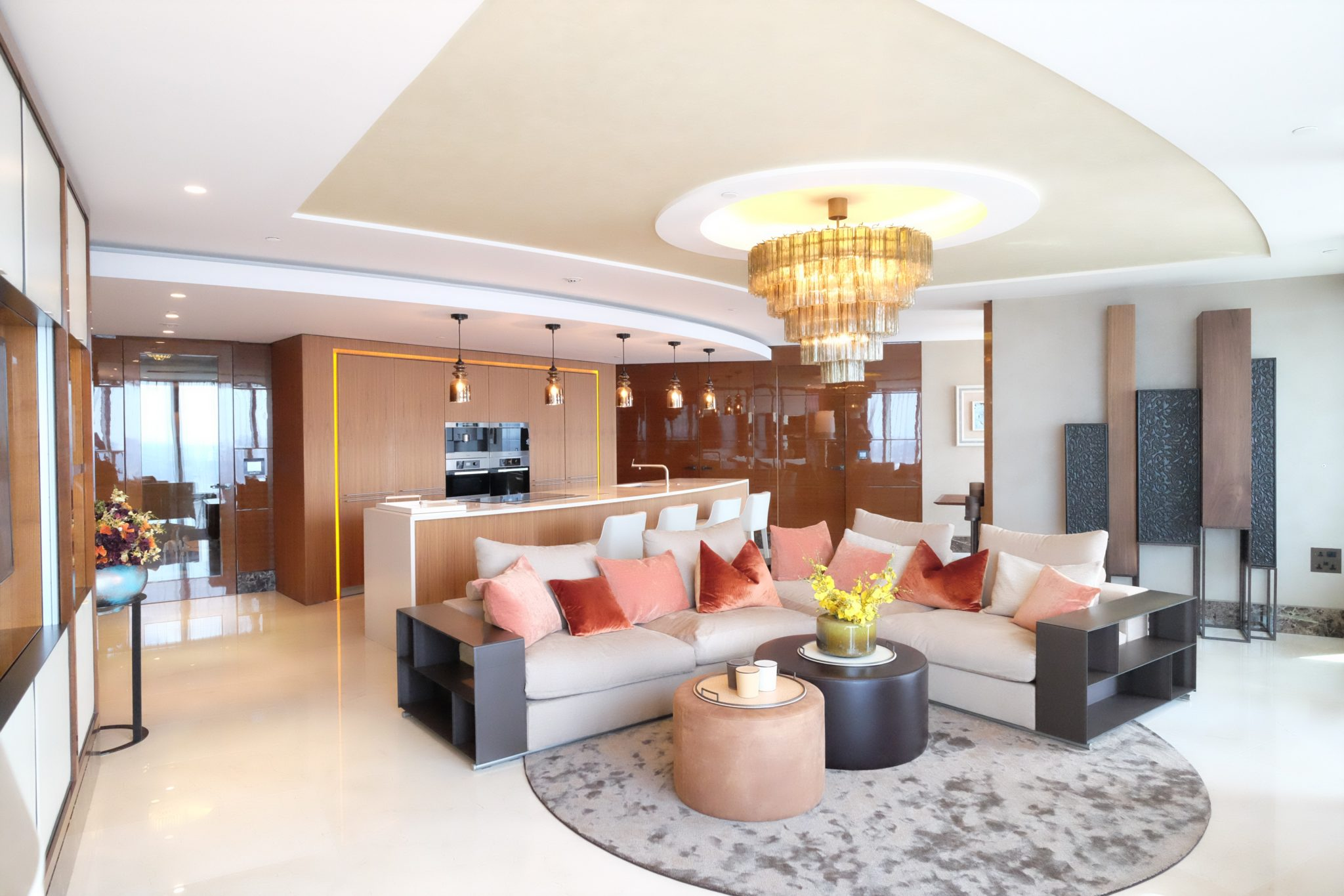 Penthouse open-plan kitchen and living room/lounge by Keir Townsend Interiors Ltd