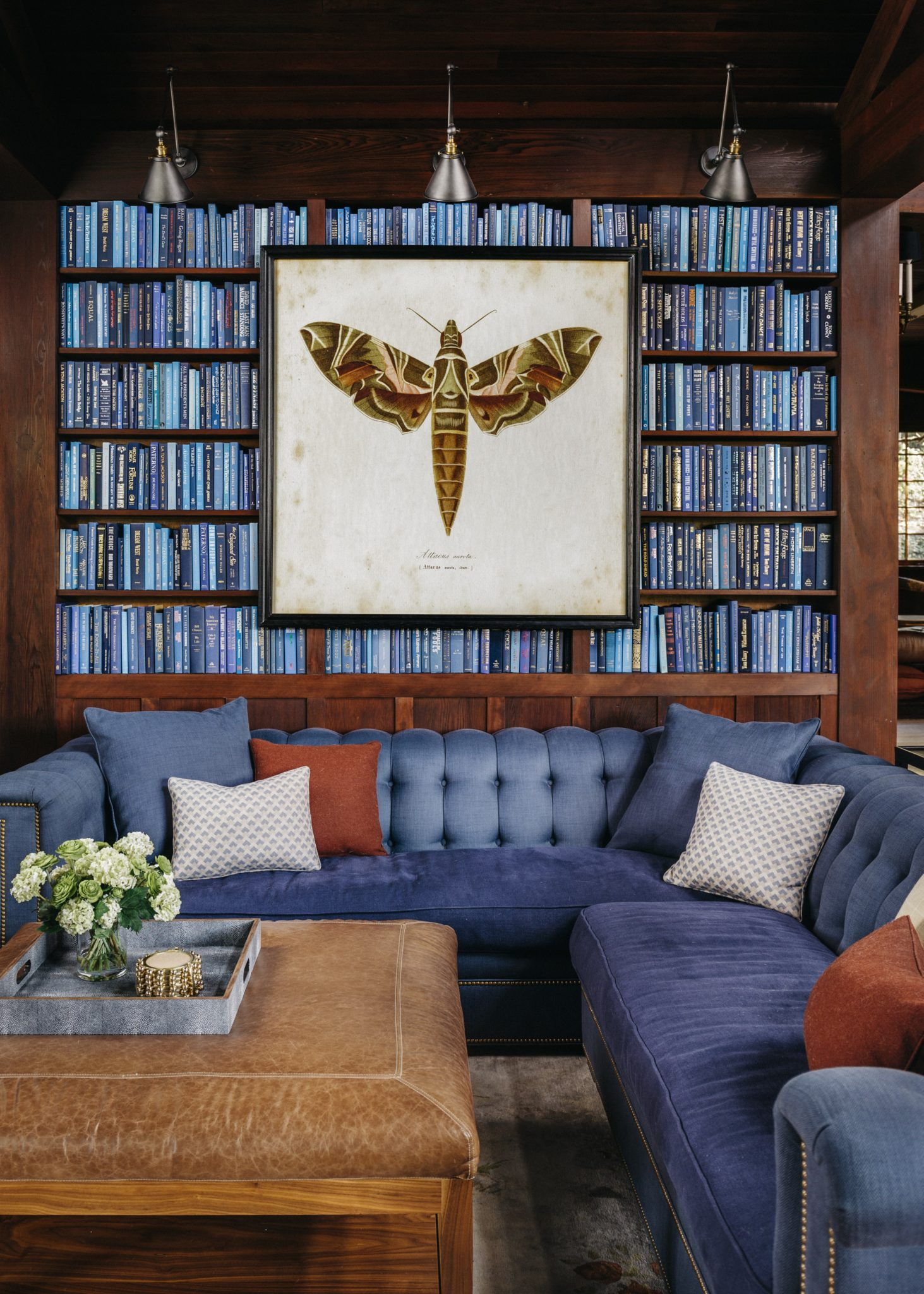A Hickory Chair sectional grounds the design in blue tones. Brown Natural Moth, the artwork,is from Timothy Oulton.