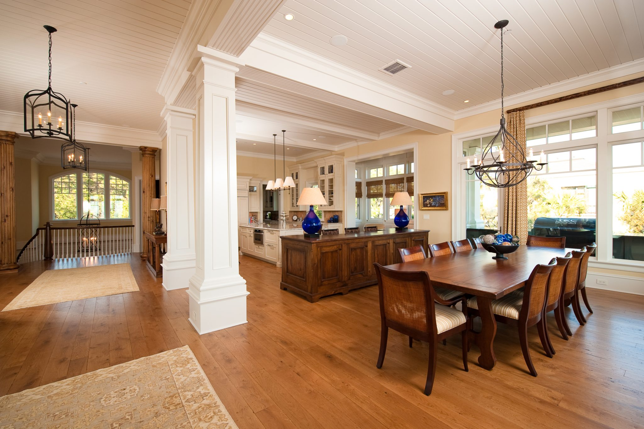 Classically detailed open concept dining room and kitchen by Island Architects