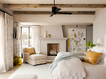 """Incorporate Simple, Layered Drapery   Through detailed drapery, a bedroom can close itself off to the outside world. Emily Turner Barker, business director at M. Elle Design, a studio co-founded by her mother and sister, Marie Turner Carson, suggests matching sheer drapery and over drapery in a bedroom to give it that extra sense of warmth and intimacy, and help with the flow of light. """"We feel it adds a sense of softness and romance and truly dresses the window,"""" says Barker. """"The sheer draperies are nice when you want some privacy that still filters the light through the space.""""  Mandell adds that when possible, it's always better to splurge for custom drapery. """"Custom drapery makes a space feel finished, tailored, and intentional,"""" she says. """"It is always worth the money."""""""