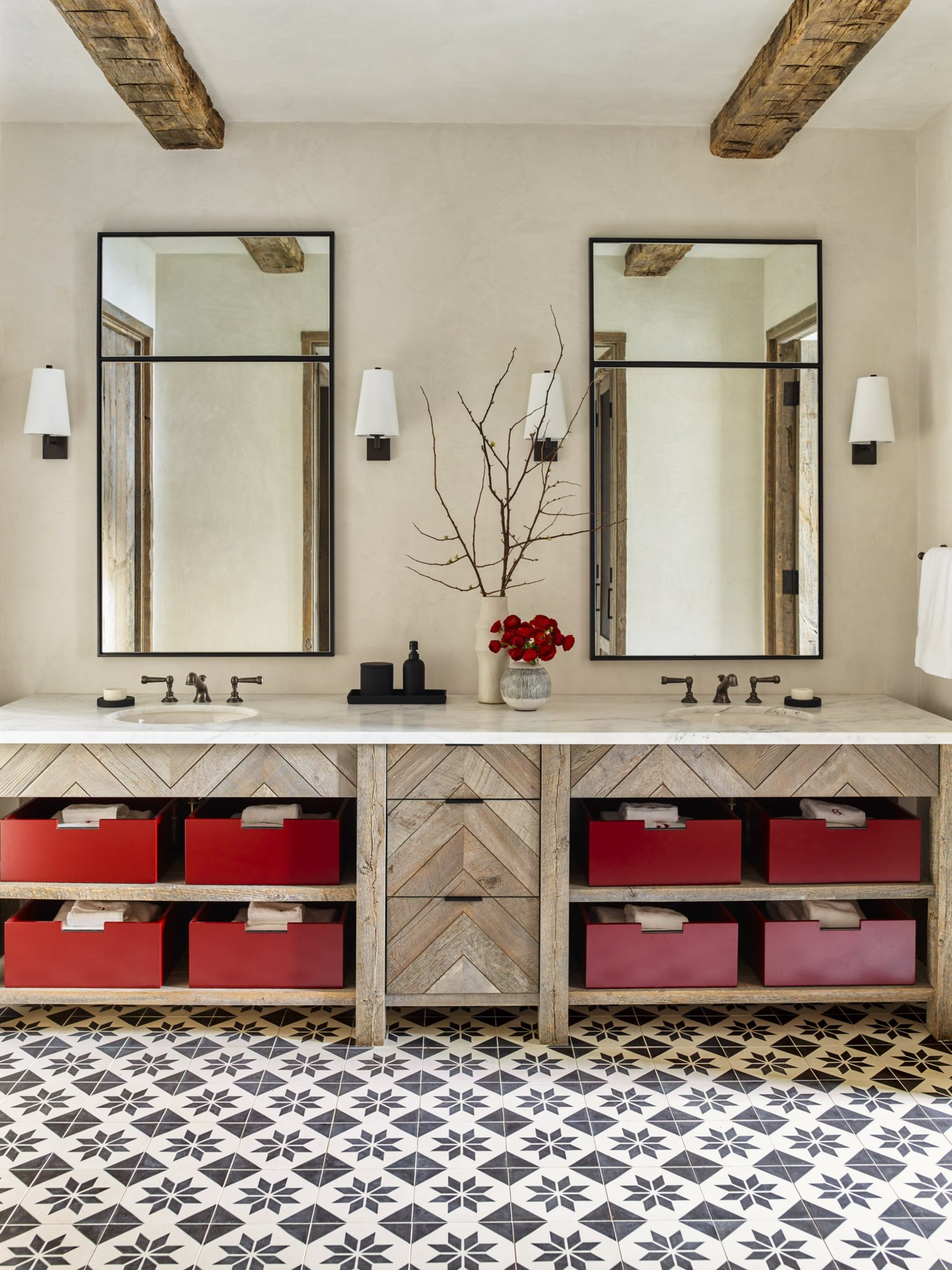 Playful yet stylish, this bathroom — complete with a custom, double vanity — is great for children. The vanity, a blend of rustic and modern design, was created using reclaimed wood, and the custom lacquered boxes add a charming pop of color.