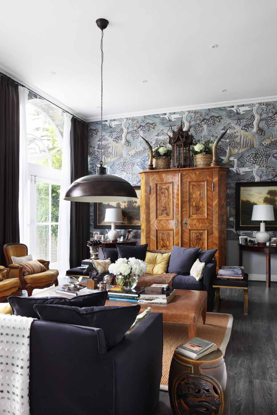 Drawing room in converted stable featuring Zoffany wallpaper and antiques by VSP Interiors