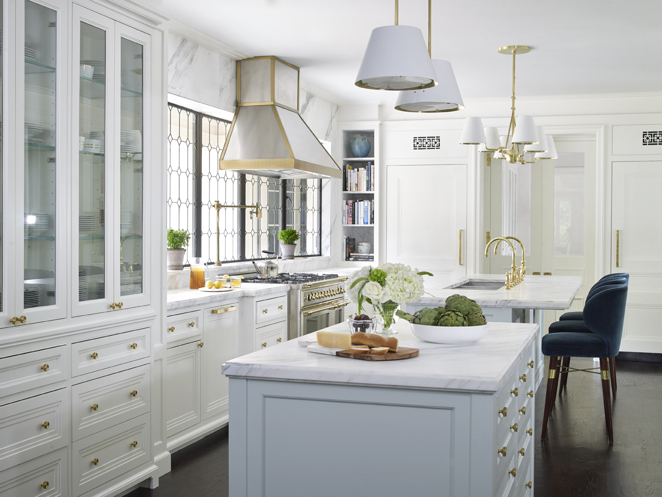 The kitchenis bright and neutral with brass accents throughout.