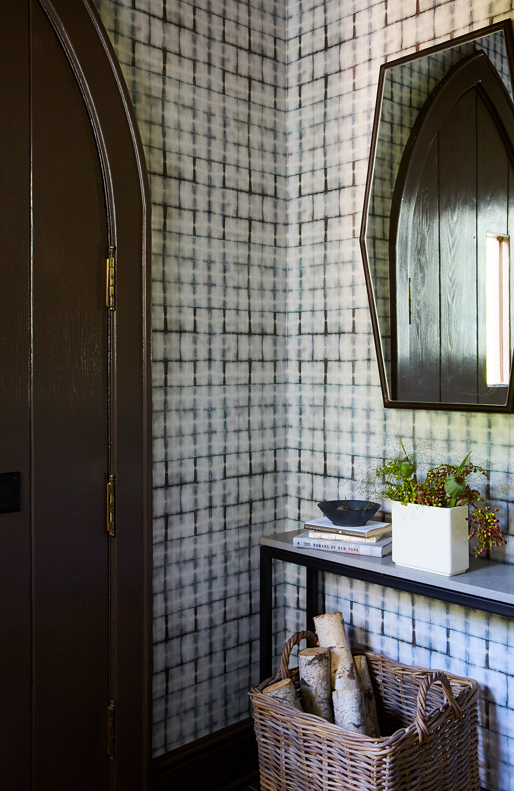 In the entryway, a bold wallcovering from Alt for Living offers guests an animated welcome.
