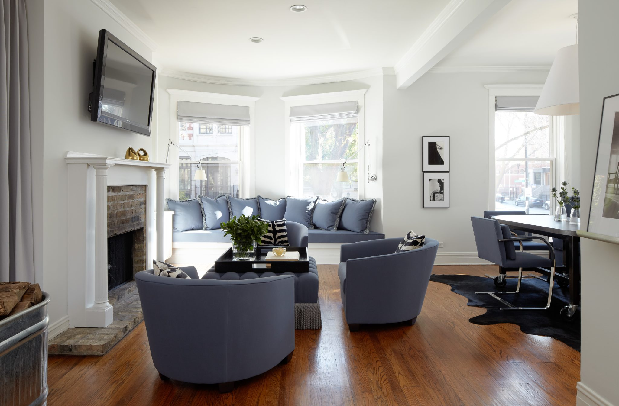 Fresh from a buying trip to Paris, Haley began the design of the apartment with the goal of combining French details and iconic American elements. In the living and dining areas, a pale lavender palette underscores the sense of calm. All of the furniture is upholstered in the same Knoll fabric.